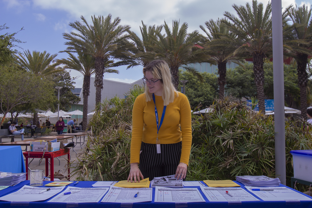 Mia Skala prepares for the annual College Fair held at Santa Monica College early in the morning on October 9, 2018.( Irving Santiago/Corsair Staff)