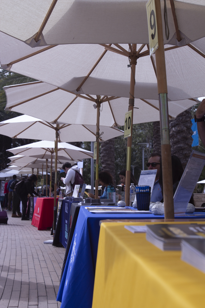 Staff from the annual College Fair wait for students at Santa Monica College early in the morning on October 9, 2018.