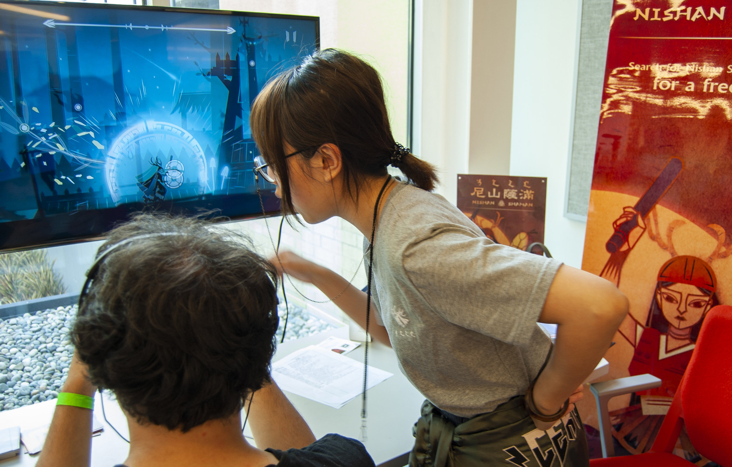 Xiao Feng, Artist/designer, Nishan Shaman game, helps a player p