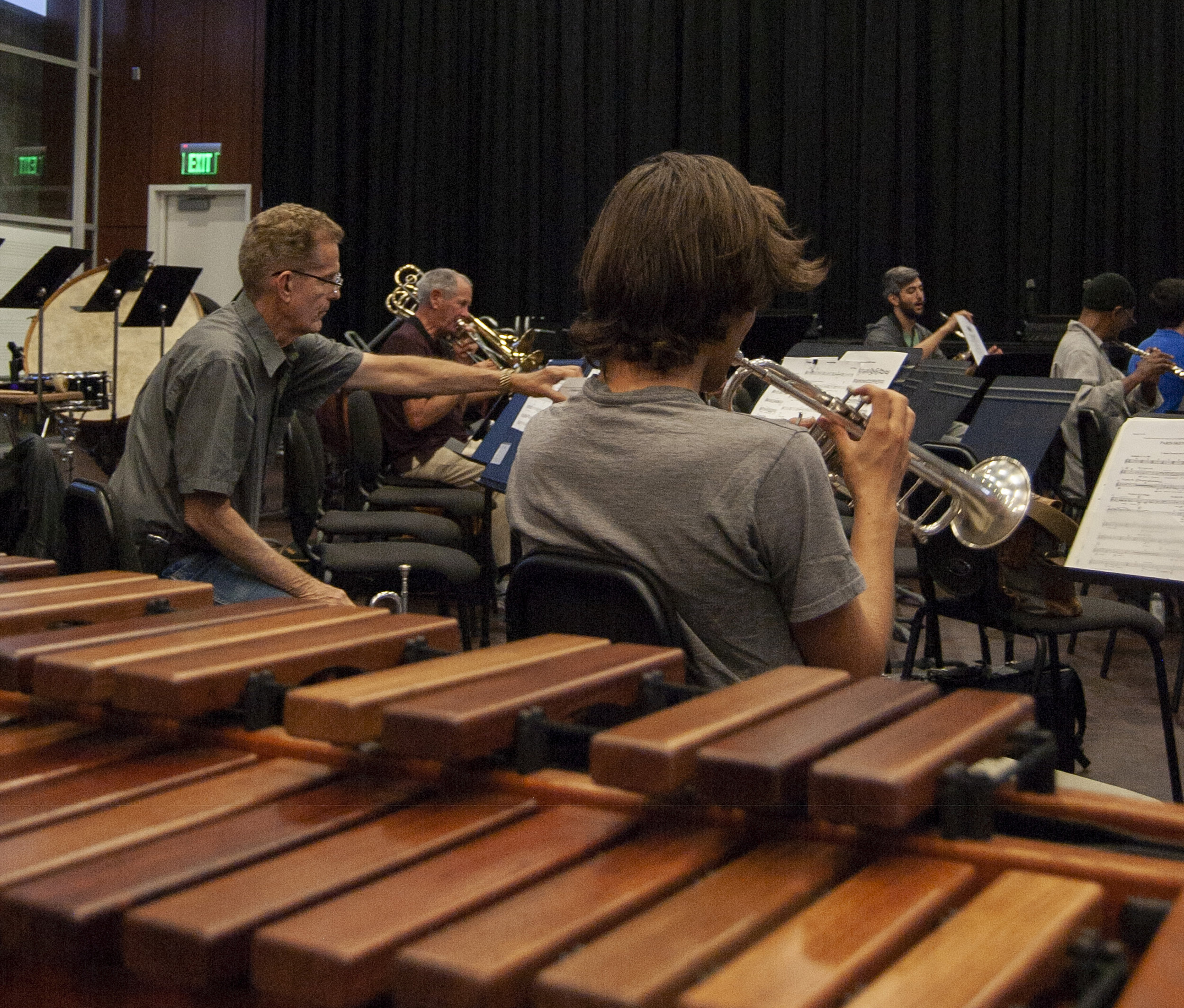 View past a xylophone as members of Santa Monica College's Wind Ensemble rehearse for an  upcoming performance, SMC Performing Arts Center, Santa Monica, Calif., September 24,  2018. (Julie Dole/ Corsair Staff)