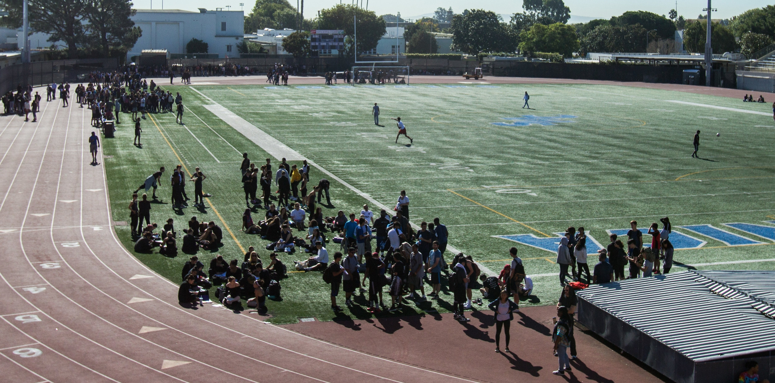 Students outside on the Corsair Field in Santa Monica College in their designated emergency positions after the alarm went off during the Earthquake Shakeout Drill on Thursday October 18, 2018 in Santa Monica, California. (Jacob Victorica/Corsiar Photo)