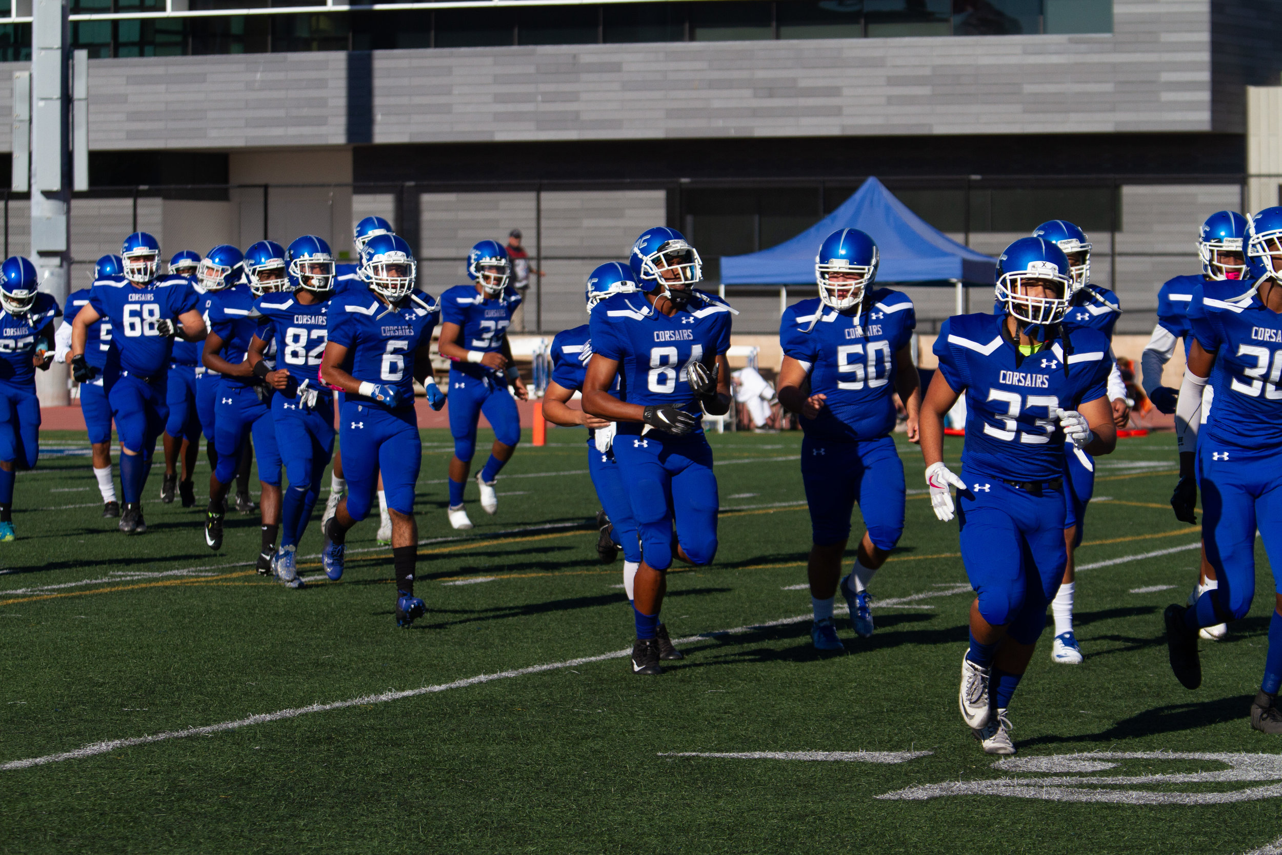 Santa Monica College Corsairs run on the Corsair Field after being announced during the homecoming game against Allan Hancock College Vikings on October 20th, 2018. Corsairs lose 52-0.(Ricardo Herrera/Corsair Photo)
