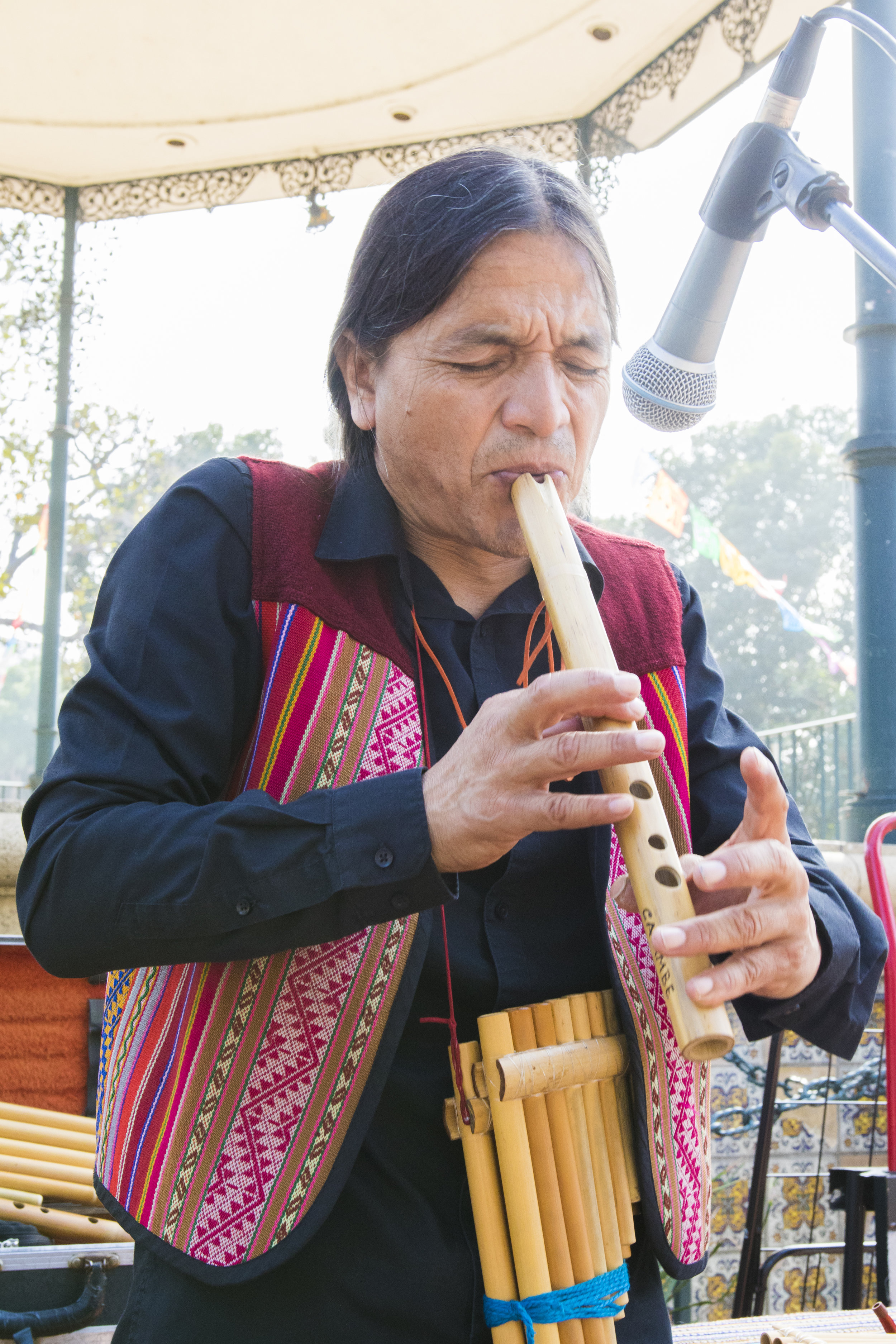 """Jonh Mosquera also known as """"Cayambe the Man from the Andes"""" performs one of his originally composed songs to a small crowd on Olvera Street on October 29, 2018. Jonh has been selling his CD's on Olvera Street since the 1990's and has seen a dramatic decline in sales in recent years. However, he does not mind, because he makes music to be happy. It is not about the money for him. (Zane Meyer-Thornton/Corsair Photo)"""
