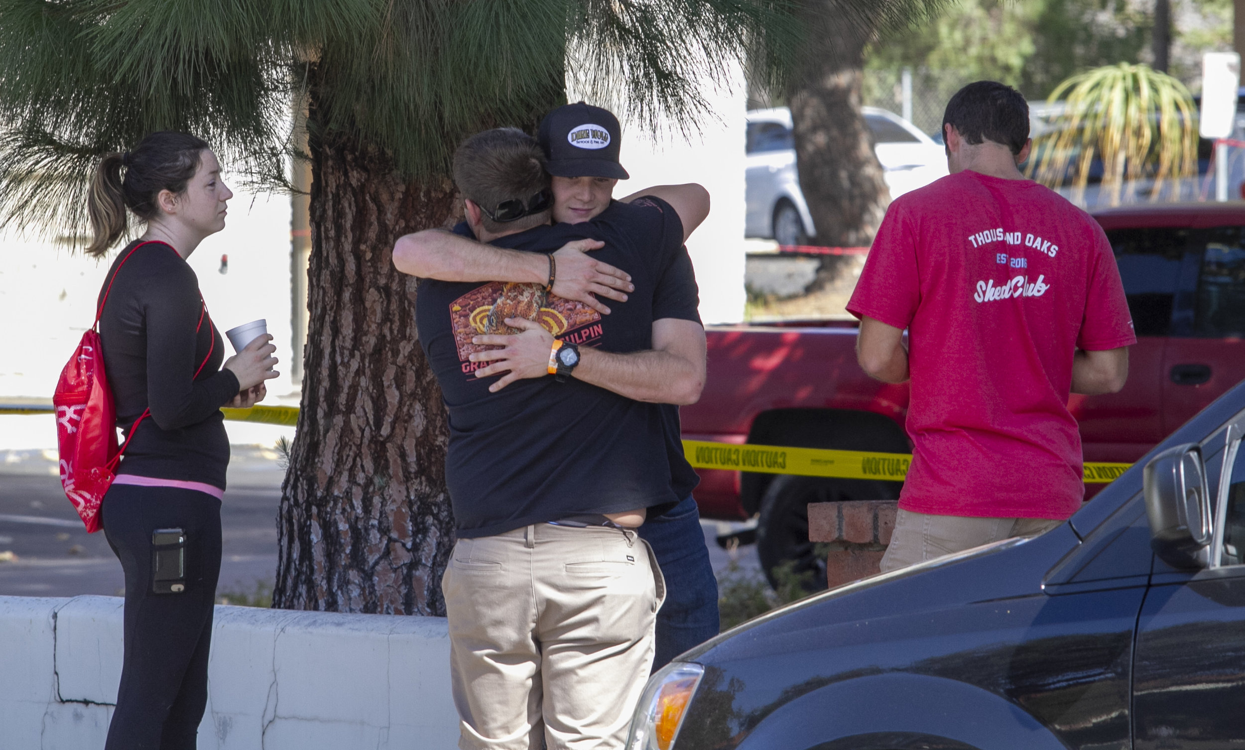 People comfort each other while waiting to speak to authorities. Ian David Long, 28, killed at least 13 and injured more than a dozen at Borderline Bar & Grill in Thousand Oaks, CA on Wednesday, Nov. 7 2018. (Andrew Navarro/ Corsair Staff)