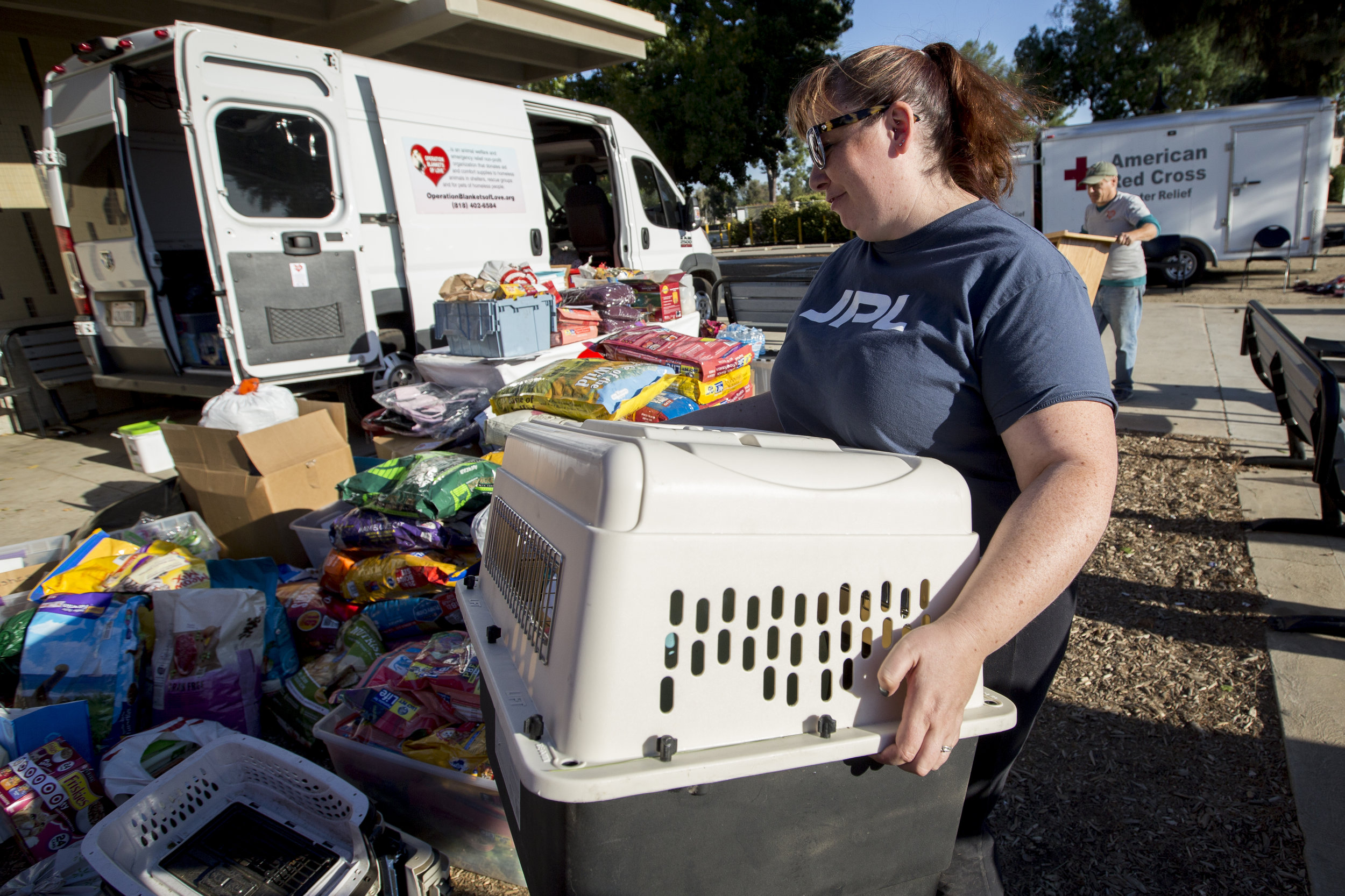 Volunteers, with Operation Blankets of Love, unload pet supplies getting ready to receive evacuated and rescued animals at the Woolsey fire evacuation center set up at Los Angeles Pierce College on November 9, 2018 in Woodland Hills, Calif. (Jose Lopez)