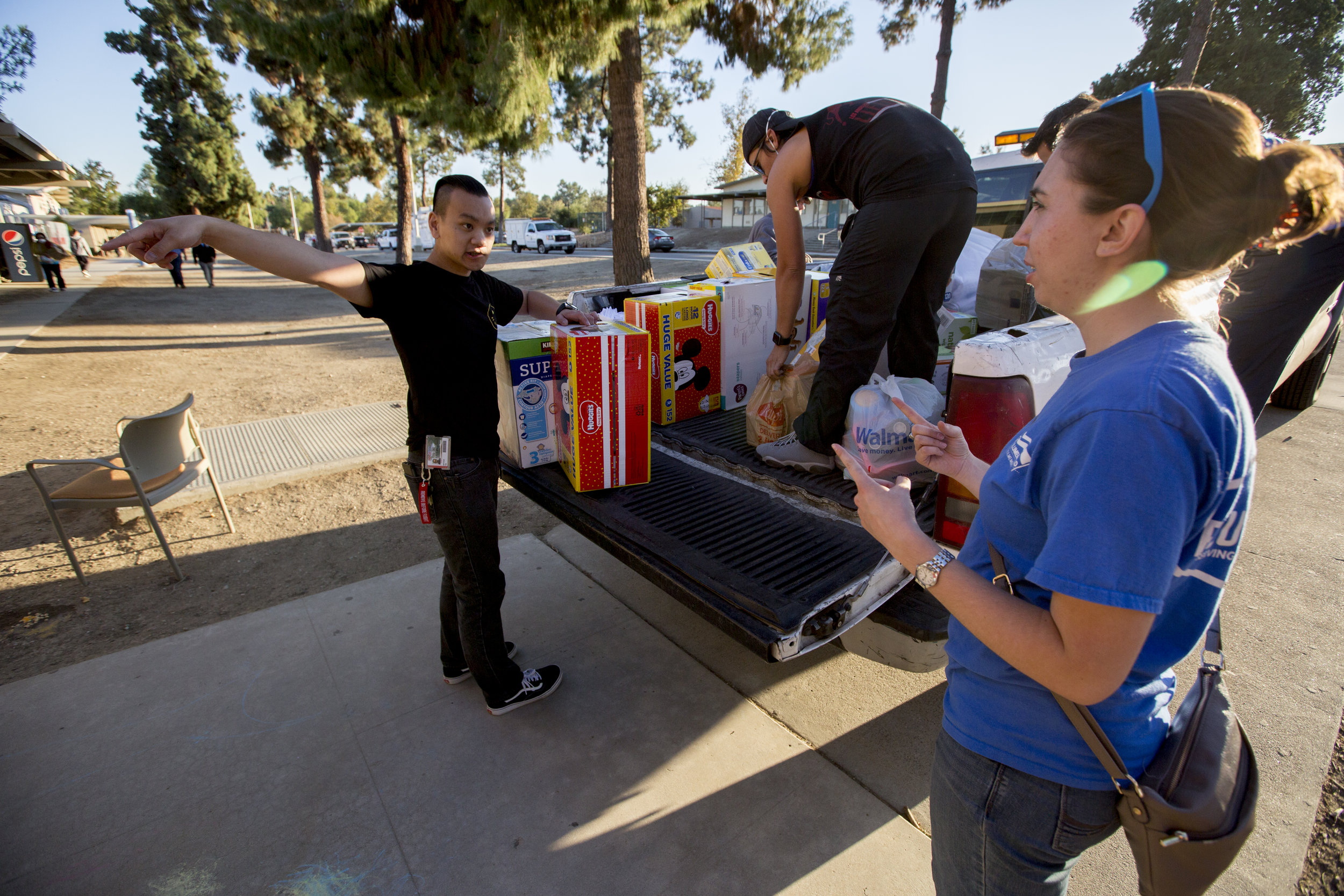 Volunteers unload supplies to help care for evacuees at the Woolsey fire evacuation center set up at Los Angeles Pierce College on November 9, 2018 in Woodland Hills, Calif. (Jose Lopez)