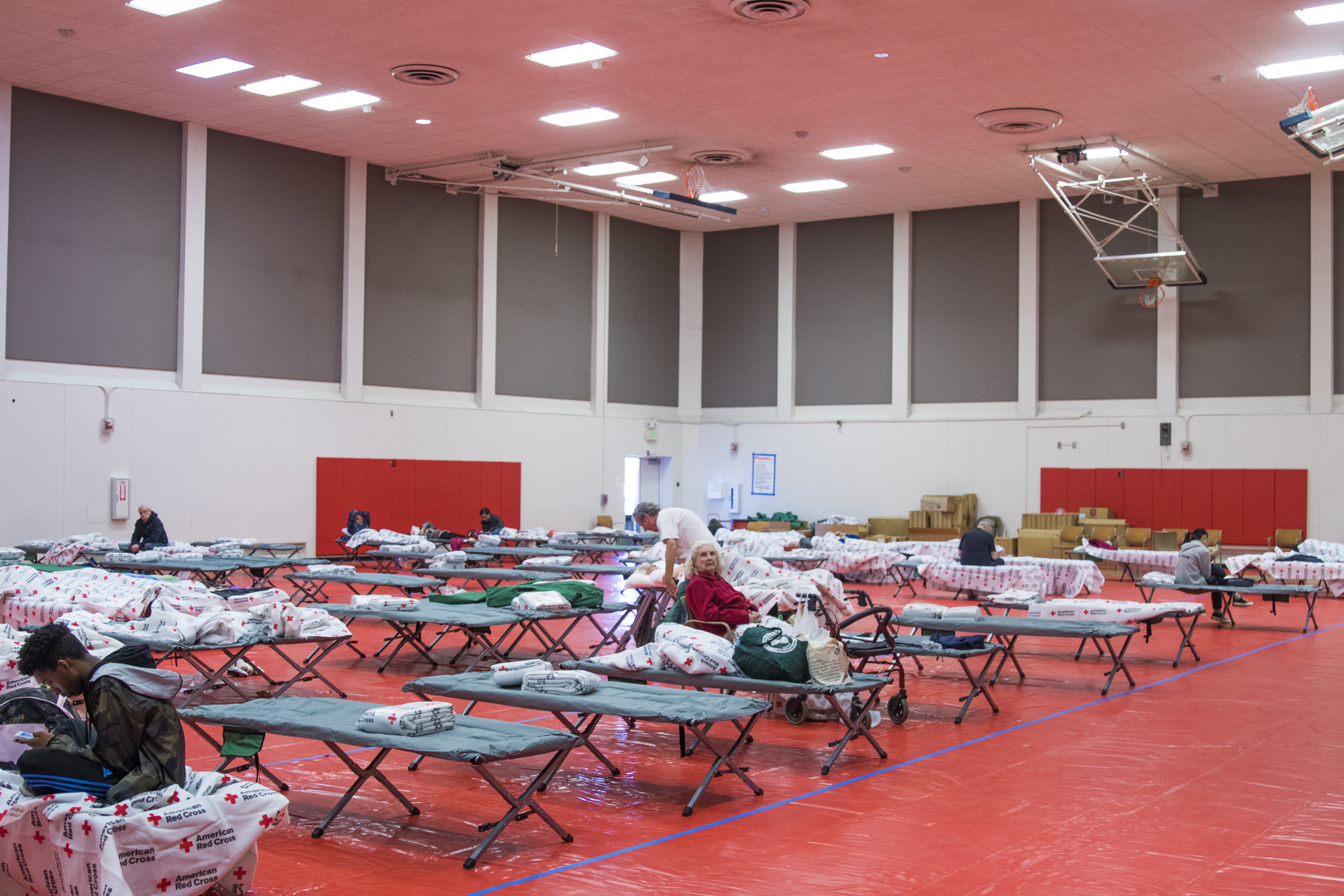 The inside of Pierce College's North Gym has been turned into an evacuation center for people seeking refuge from the Woolsey Fire on November 9, 2018. The college is located in Woodland Hills, California. (Zane Meyer-Thornton/Corsair Photo)