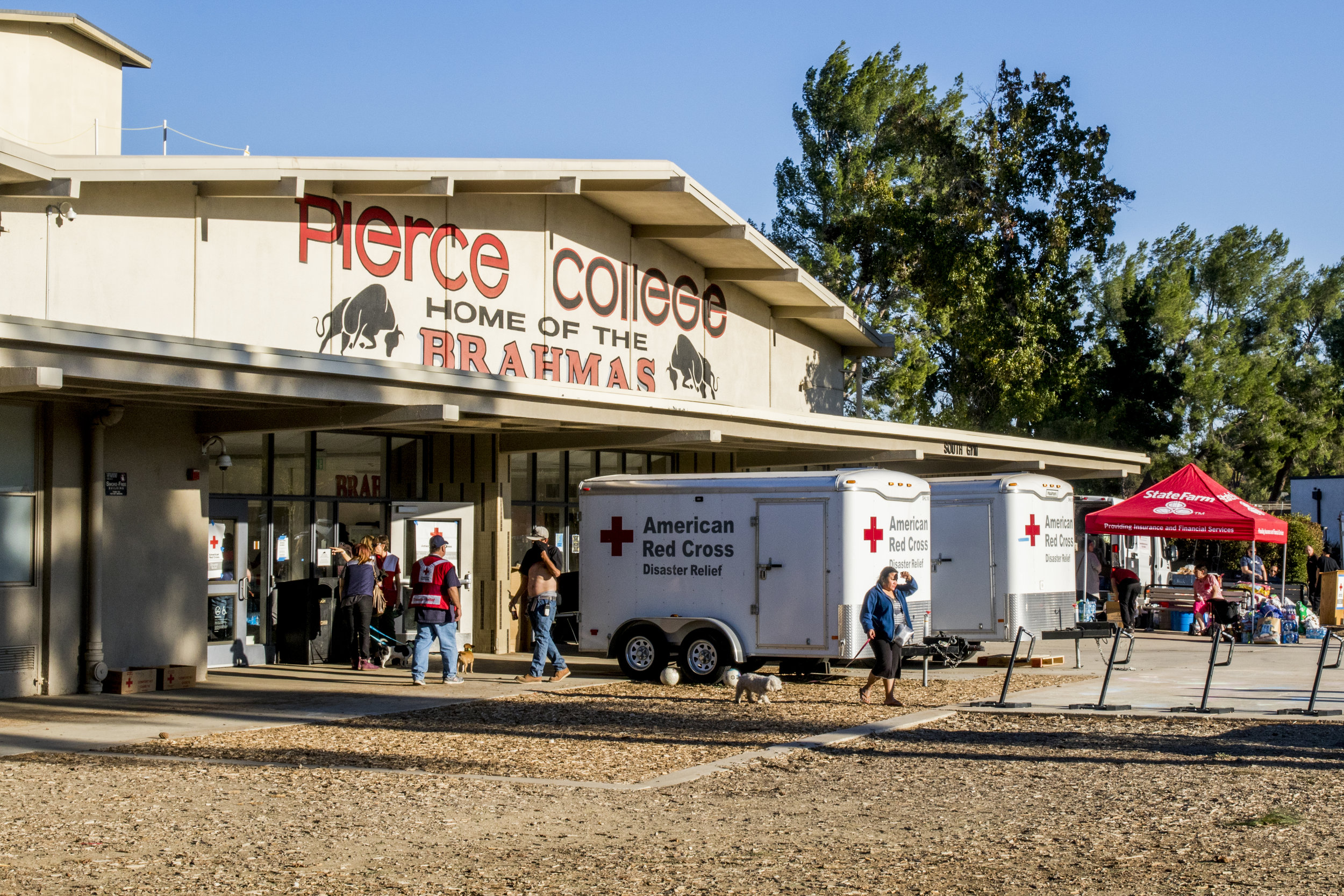 The American Red Cross and State Farm Insurance have set up outside of Pierce Colleges South Gym in Woodland Hills, California on November 9, 2018. The organizations are at the college to provide supplies and support to any person or animal seeking refuge from the Woolsey Fire. (Zane Meyer-Thornton/Corsair Photo)