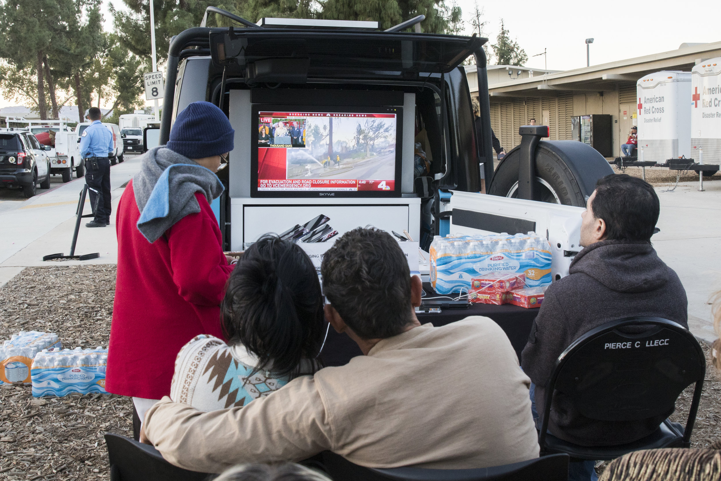 People at an evacuation center located at Pierce College in Woodland HIlls, California watch live news to get updates on their homes on November 9, 2018. (Zane Meyer-Thornton/Corsair Photo)