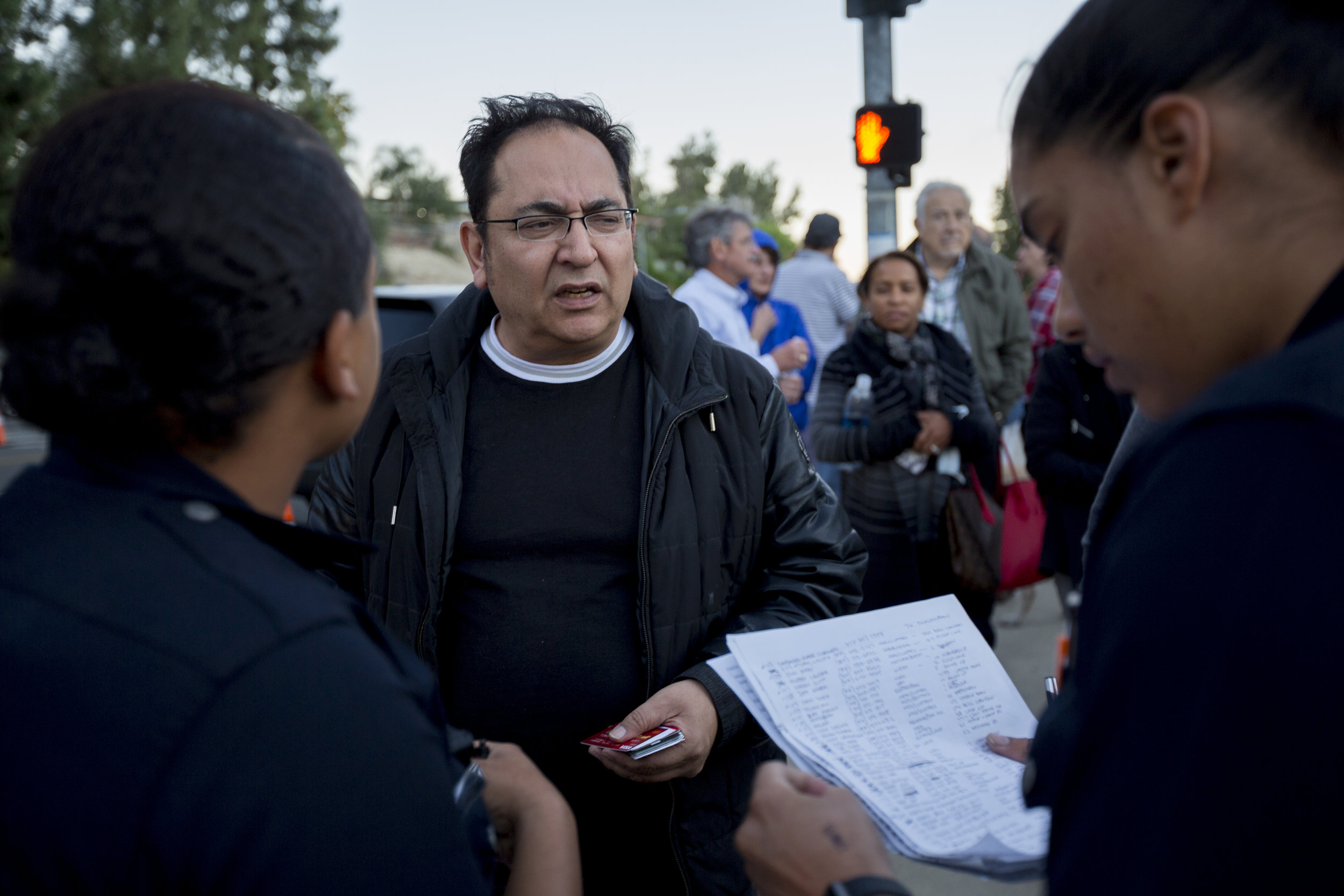 Bell Canyon neighborhood residents gather along Valley Circle Blvd to place their names on a list for a police escort to their homes on November 12, 2018 in West Hills, Calif. Police are allowing residents to have up to 10 minutes to gather any important items since an evacuation order is in effect for the area. (Jose Lopez)