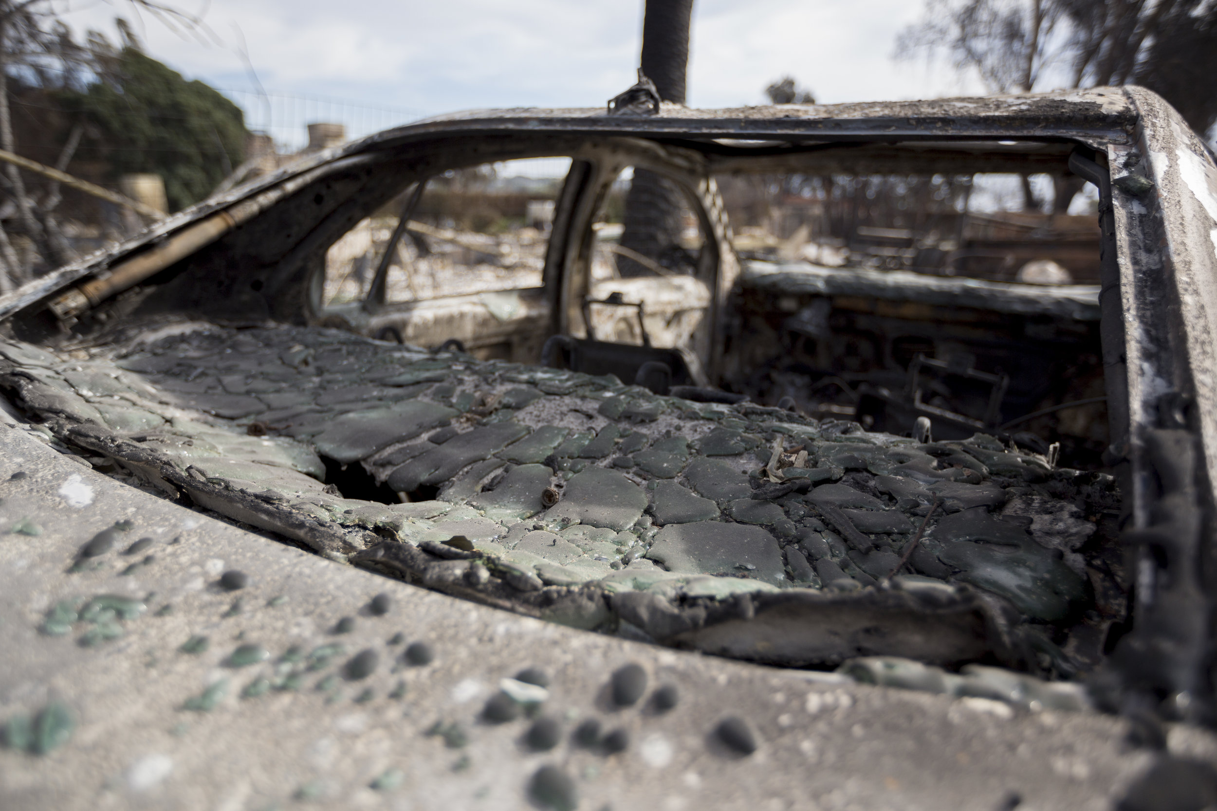 A car destroyed by the Woolsey fire sits along Filaree Heights Ave with its rear glass window melted on November 14, 2018 in Malibu, Calif. (Jose Lopez)