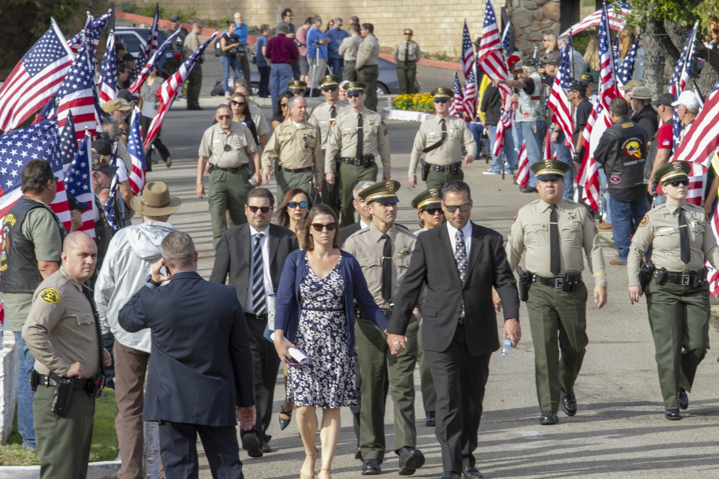 Attendees walk to the final burial site for Sgt. Ron Helus at Pierce Brothers Valley Oaks Park in Westlake Village, California on Thursday, Nov. 15, 2018. (Photo by Andrew Narváez)