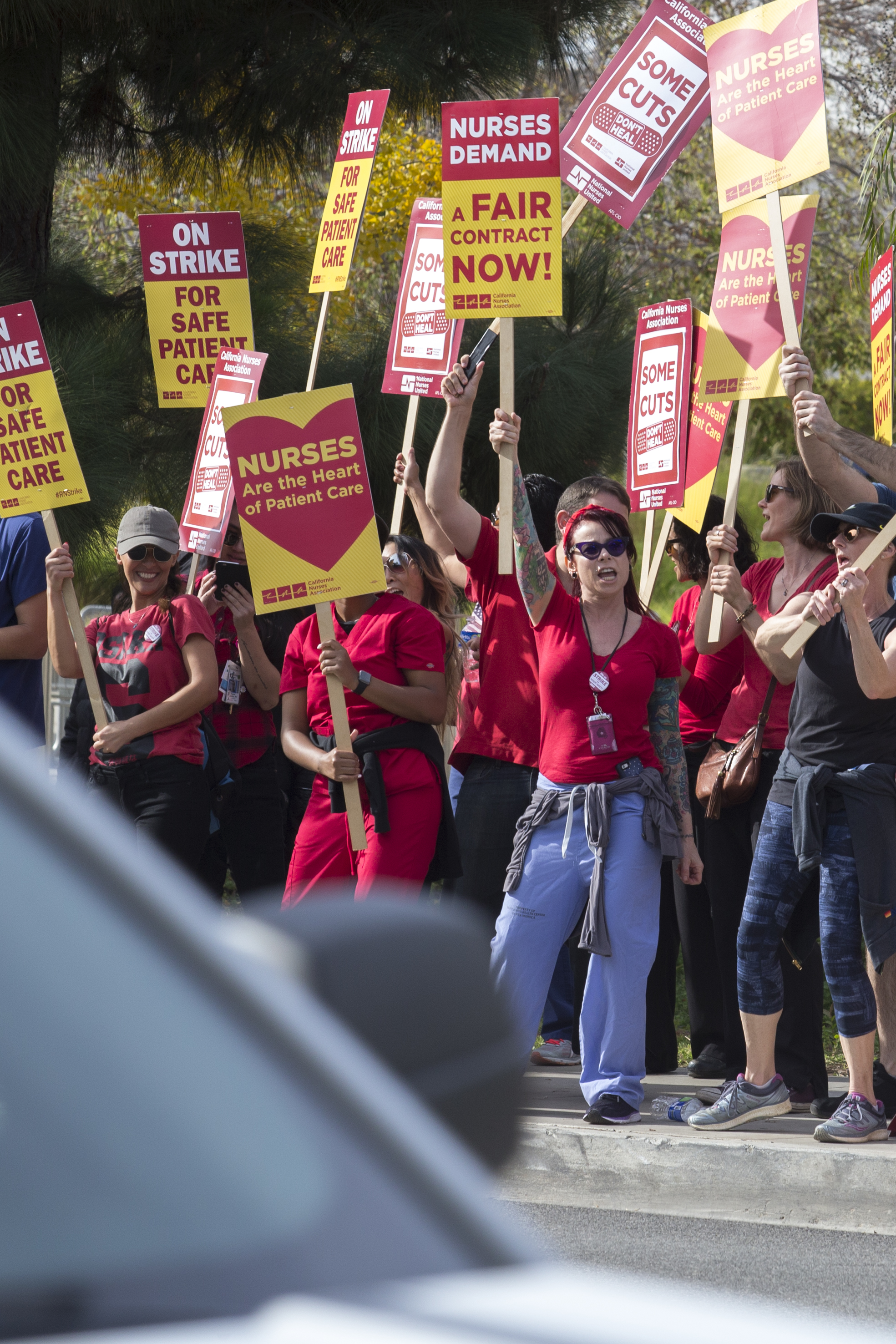 Members of the California Nurses Association protest at a Nurses Strike outside of Providence Saint Johns Health Center in Santa Monica, California on November 27, 2018. The nurses were striking over the unfair treatment they are receiving from Providence Health and Services. (Zane Meyer-Thornton/Corsair Photo)