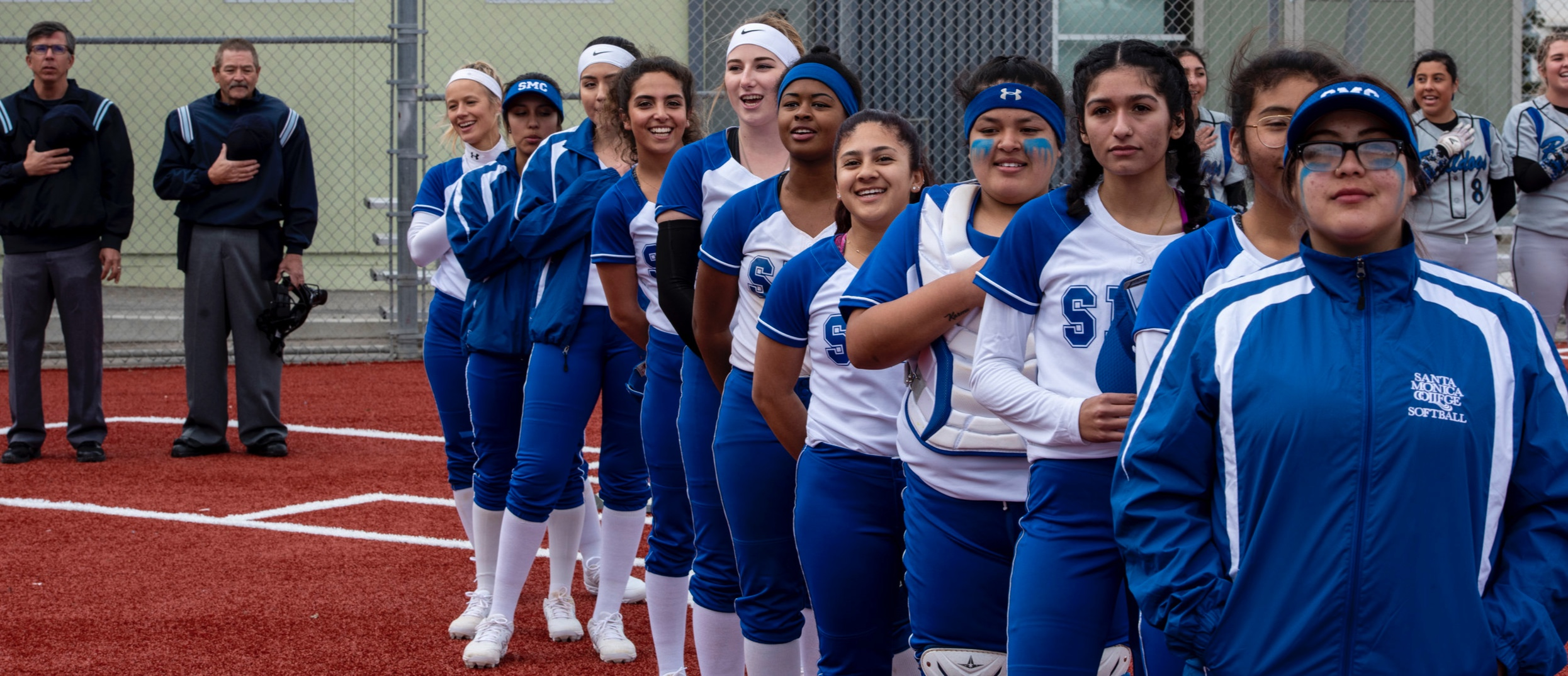 The female Corsair softball team stand for the national anthem on Thursday, February 21, 2019. They defeated the Allen Handcock Bulldogs 1-0 with seven strike outs and no runs. (Clyde Bates Jr./The Corsair)