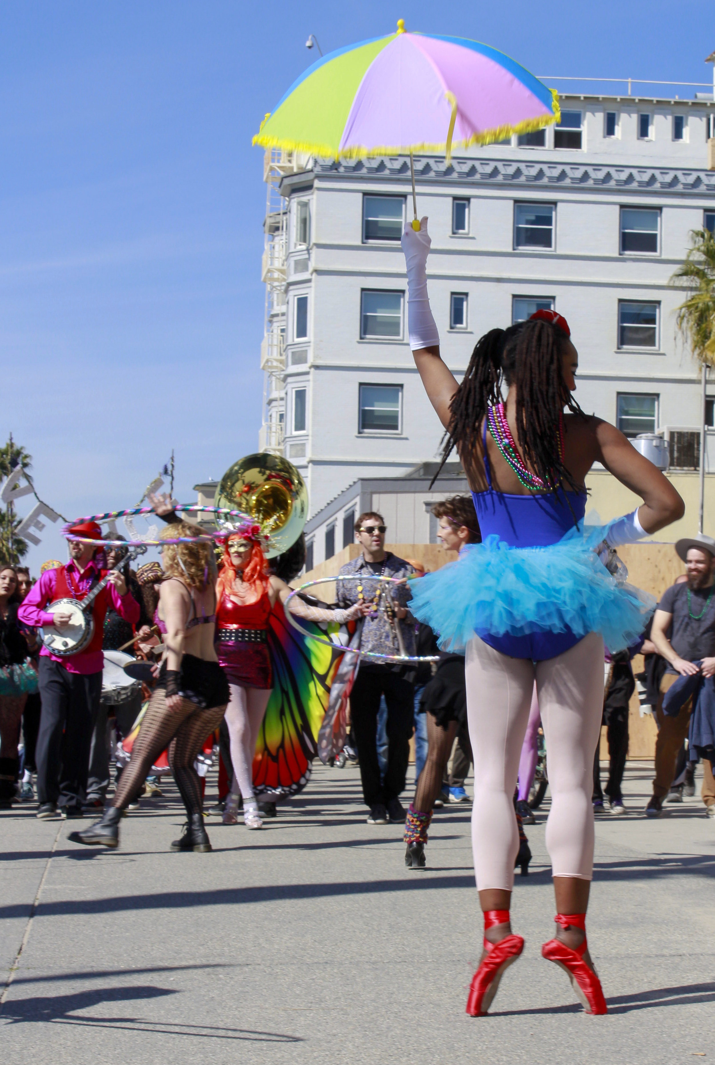 The Venice Beach Mardi Gras parade picking up steam on the boardwalk of Venice Beach in Los Angeles, California on Feb 23, 2019. Photo by Danica Creahan.