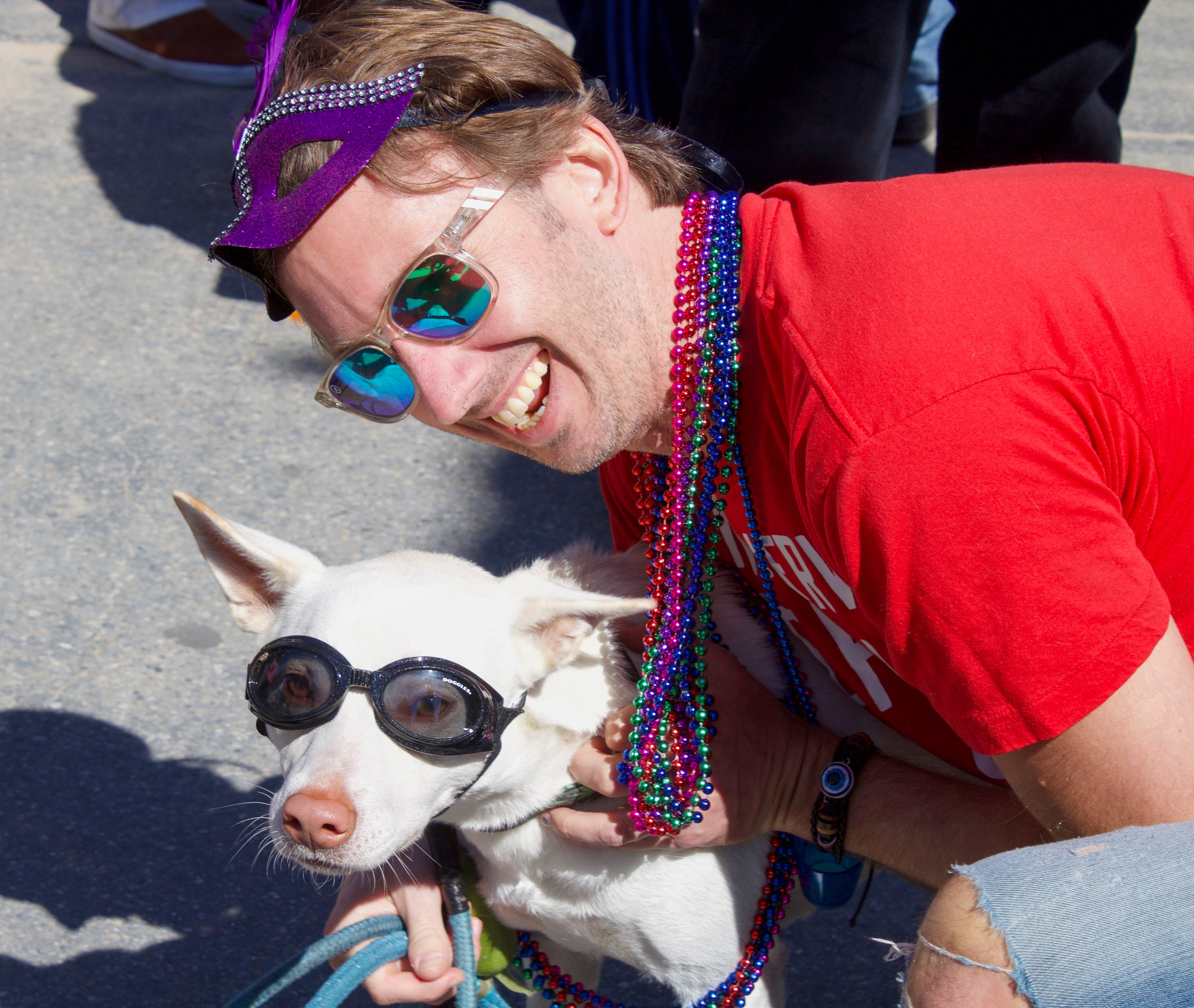 Yogi and his owner, Timothy Hansen, pose for a photo from a passerby as they wait for the 17th annual Venice Beach Mardi Gras parade to begin on Feb 23, 2019, in Los Angeles, California. Photo by Danica Creahan.