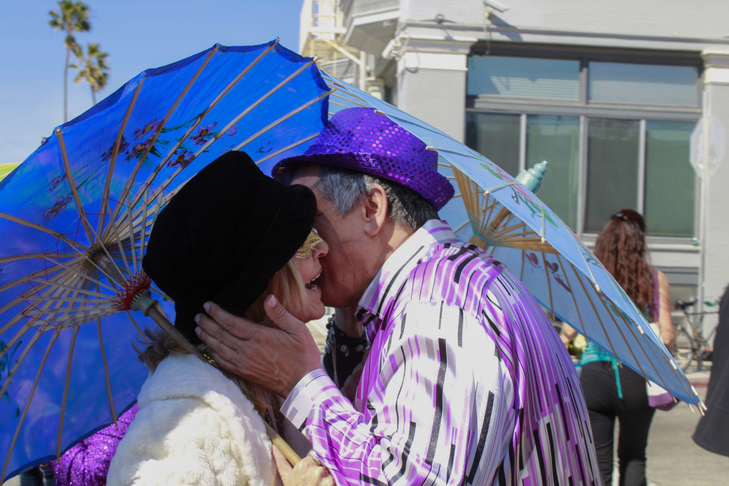 Gretchen Neville and Damian Boudreaux greeting one another at the pre-parade gathering of the 17th annual Venice Beach Mardi Gras parade, in Los Angeles, California. Feb 23, 2019. Photo by Danica Creahan.