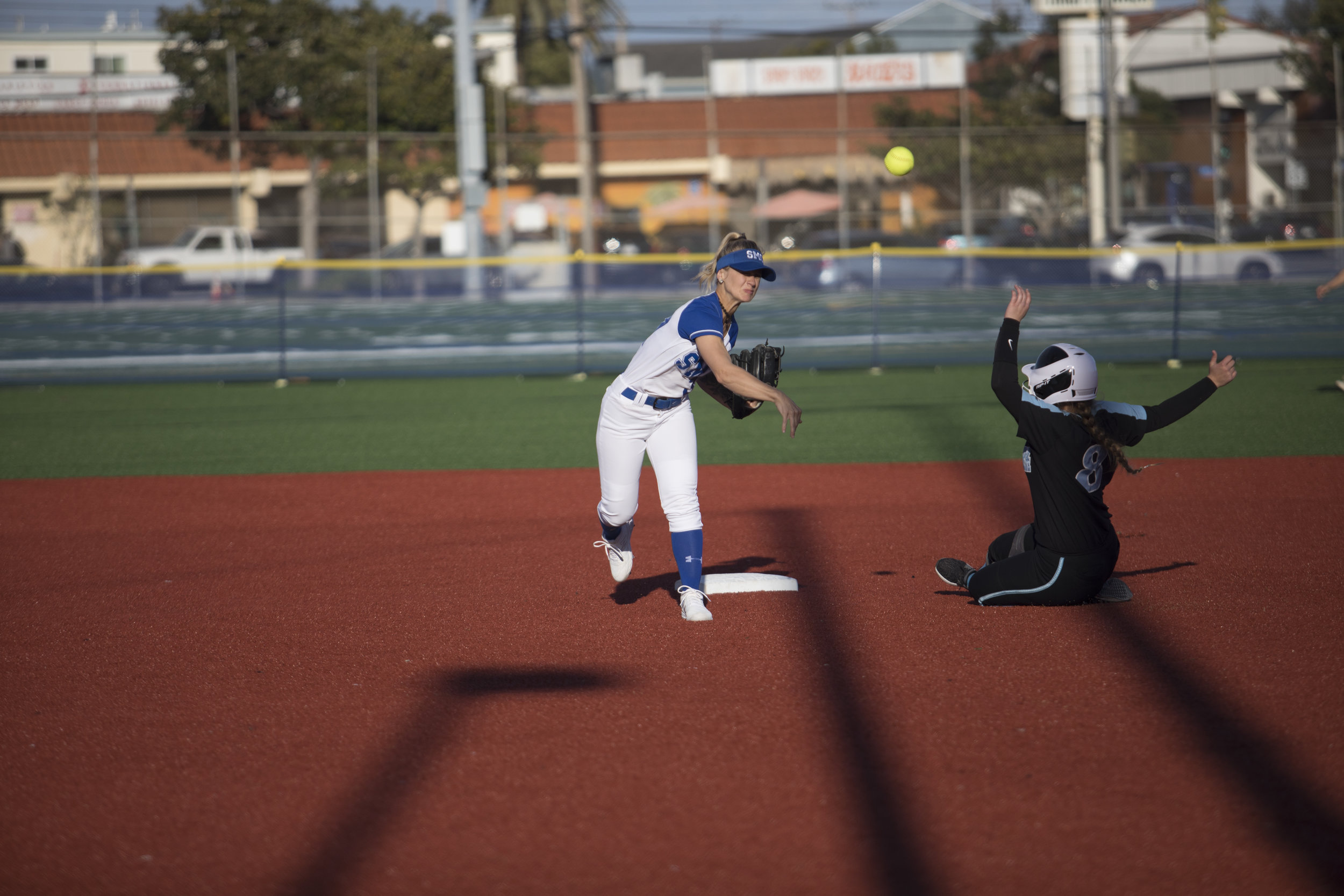 PItcher Ireland Miessau of the Santa Monica Corsairs gets out Victoria Villegas from the Moorpark College Raiders at Santa Monica College on Thursday March 7, 2019. Final score 9-5 for the Corsairs. Photo by Tanya Barcessat