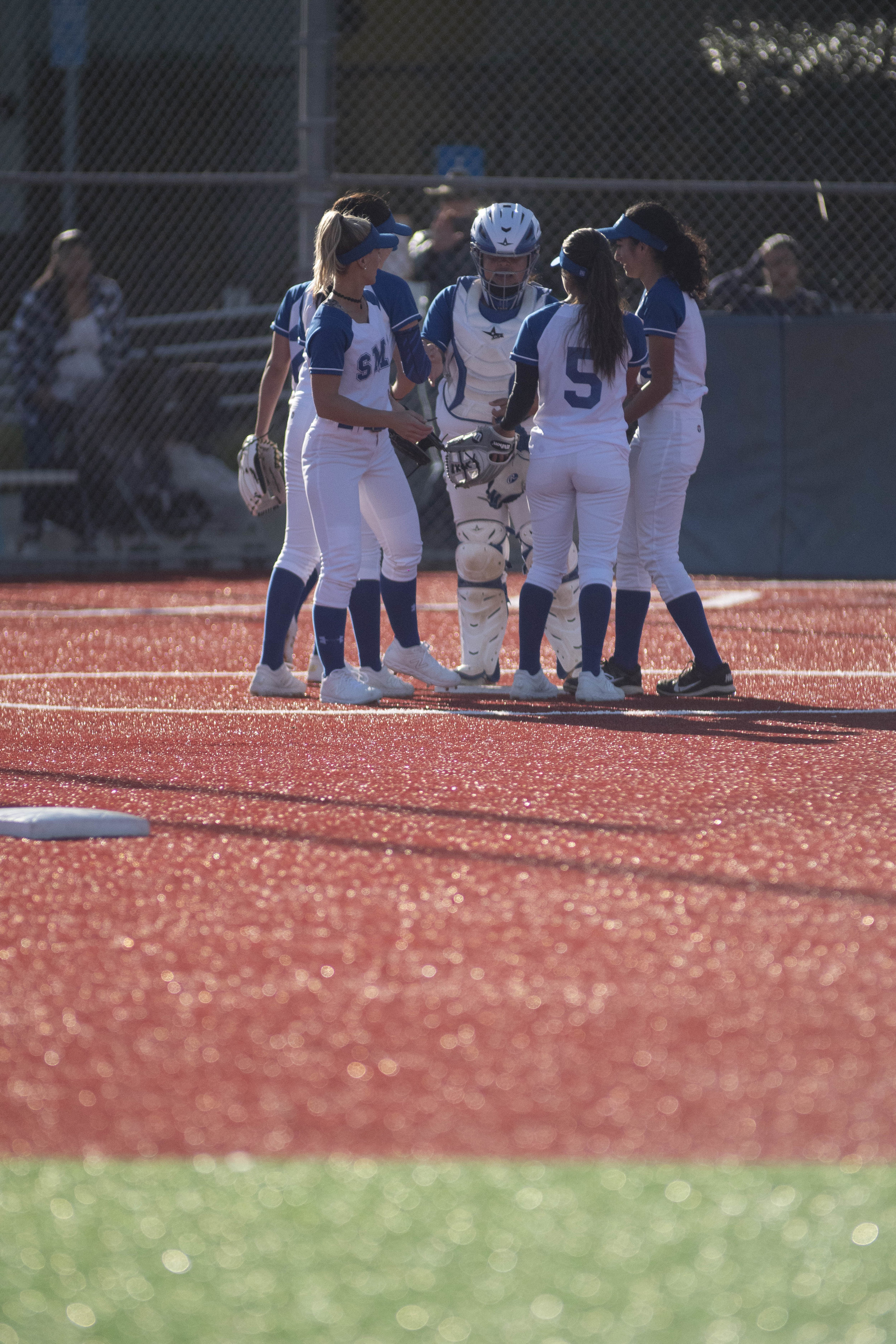 The Corsairs huddle on Thursday afternoon, March 7, 2019, as the Santa Monica College Corsair's softball team defeated the Questa College Cougars. (Victor Noerdlinger/Corsair Staff)