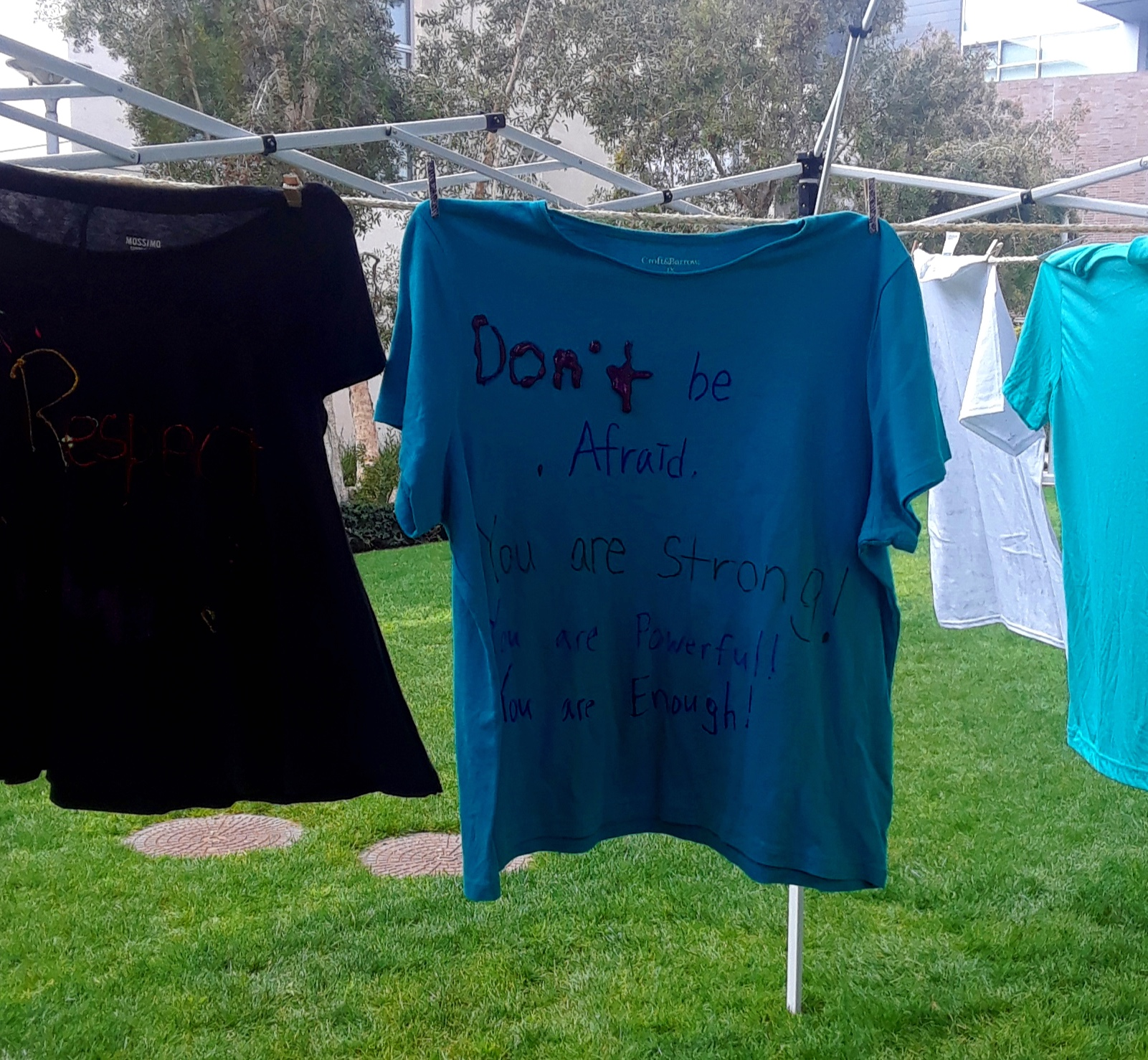 T-shirts from the Clothesline Project honor domestic violence victims in Santa Monica College on Tuesday, March 5 in Santa Monica, California. Martha Ramirez/ The Corsair