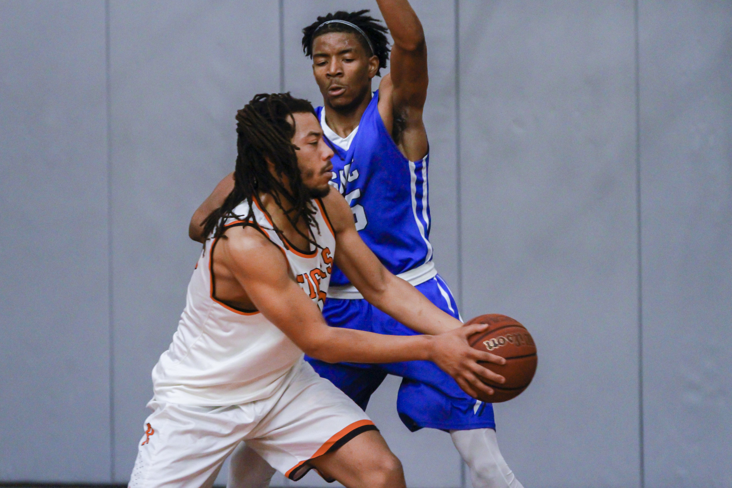 Kyle Young of the Santa Monica Corsairs and Frank McQuay of the Riverside City College Tigers at Riverside City College on Saturday March 9, 2019. The Corsairs defeated the Riverside Tigers 66-54, to claim the regional final. Photo by Tanya Barcessat