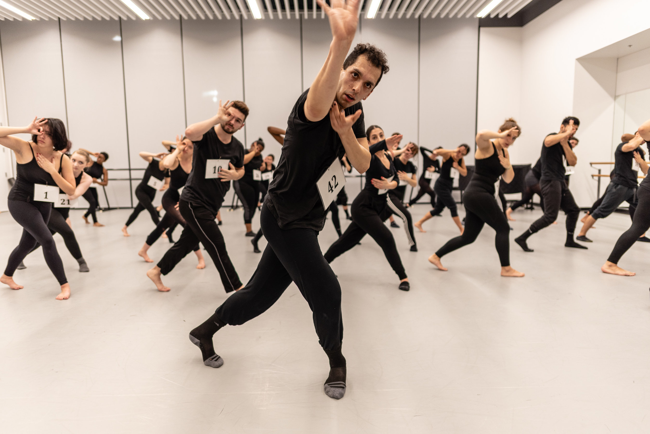 Student choreographer Erik Fine (#42) teaches SMC dancers a combination during the auditions for Synapse Dance Theater in SMC's Core Performance Center on Thursday, Feb. 21, 2019. The title of Fine's piece is the number seven written in tally marks. Synapse Dance Theater will feature 11 works by SMC student choreographers, faculty, and guest artist Jay Carlon on the Broad Stage at SMC's Performing Arts Center campus on Friday and Saturday, May 24 and 25. (Glenn Zucman/The Corsair)