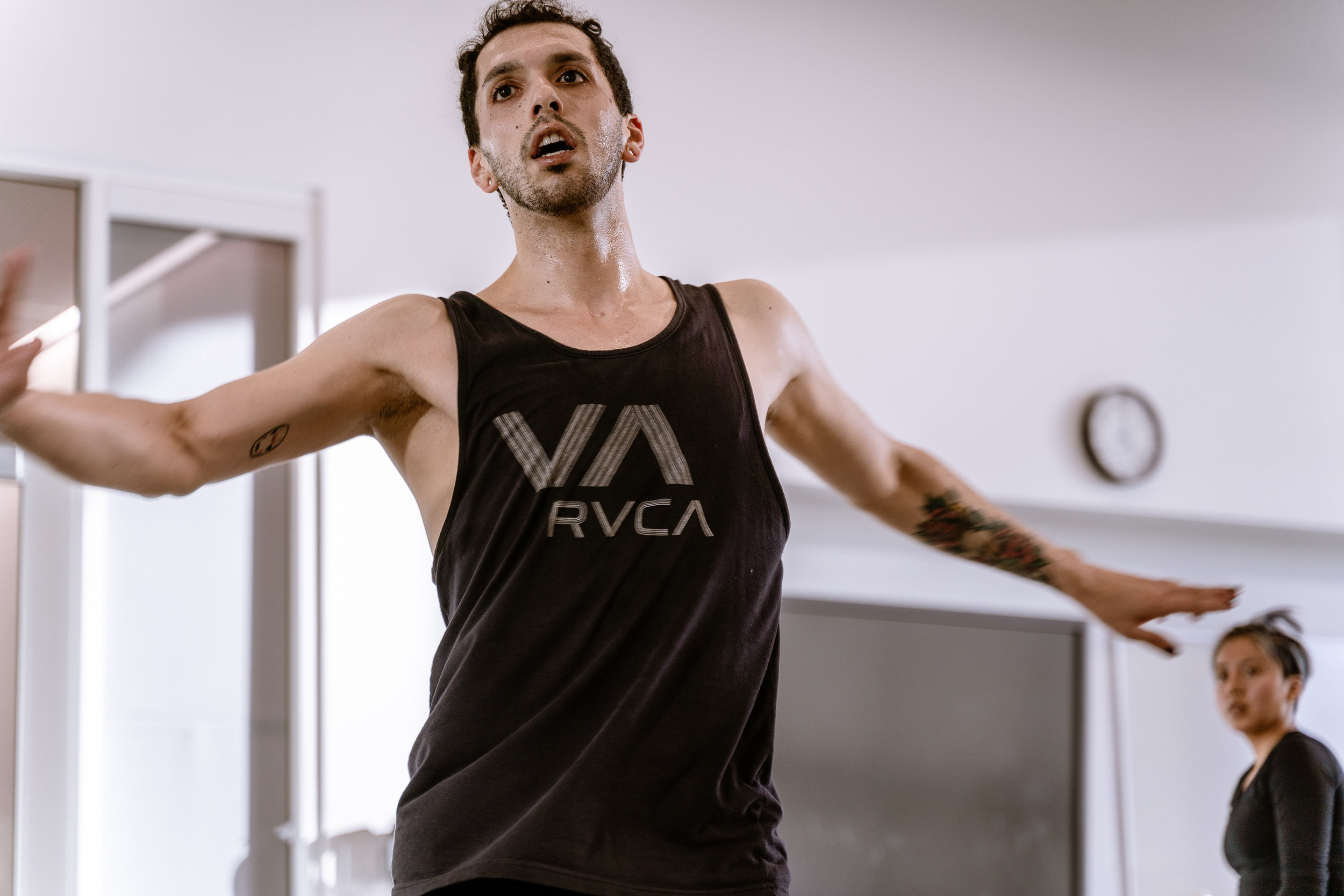 """Student choreographer Erik Fine, 27, from Chicago, teaches a movement phrase to dancers in his new work titled by the number seven written in tally marks at SMC's Core Performance Center on Thursday, March 7, 2019. """"seven"""" will premiere at Synapse Dance Theater at the Broad Stage at SMC's Performing Arts Center campus on Friday and Saturday, May 24 and 25. (Glenn Zucman/The Corsair)"""