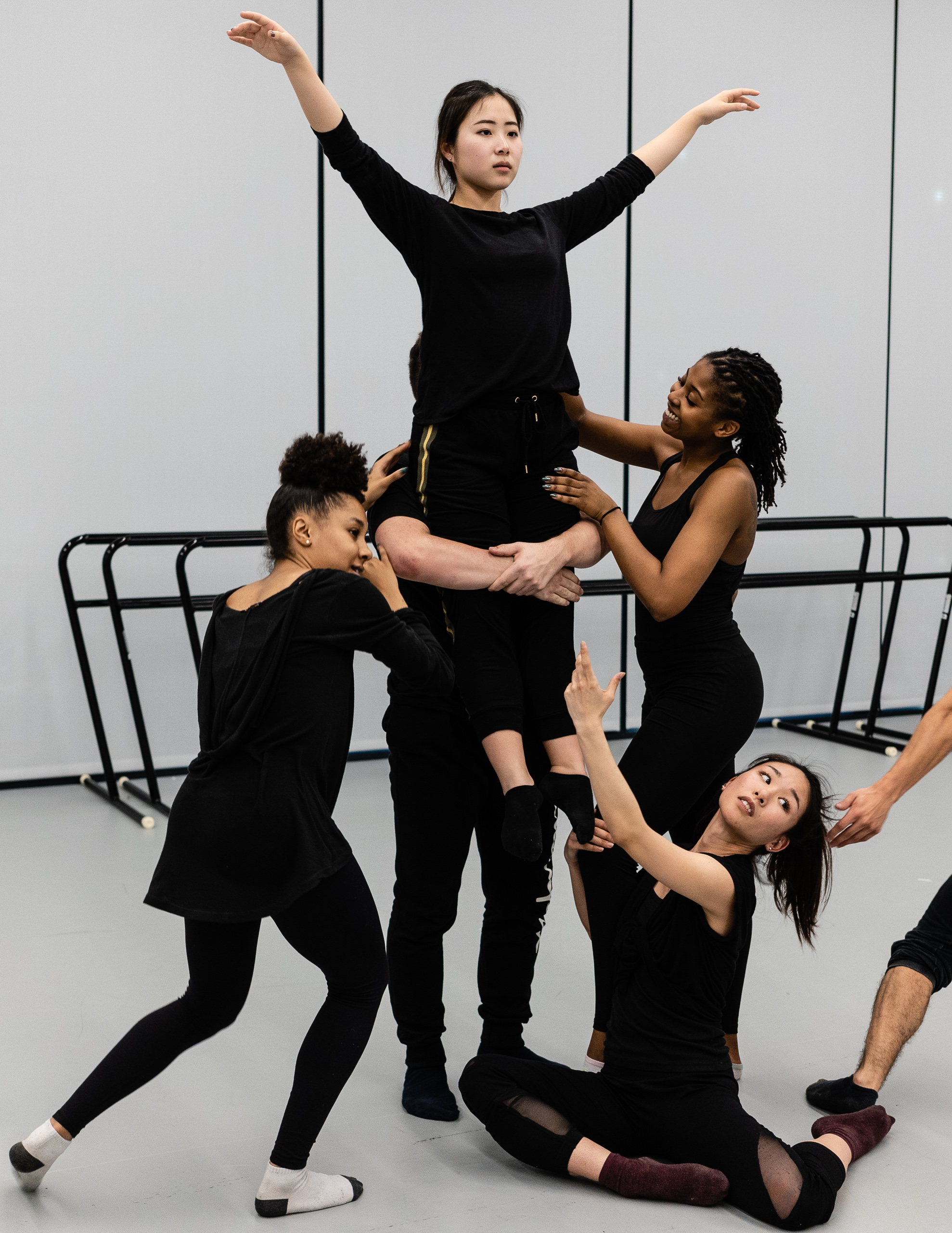 SMC dance major Yurino Niyama is held aloft by dancers in a rehearsal at SMC's Core Performance Center on Tuesday, Feb. 26, 2019. The dancers are rehearsing for student choreographer Erik Fine's new work titled by the number seven written in tally marks. Fine's choreography will premiere at Synapse Dance Theater at the Broad Stage at SMC's Performing Arts Center campus on Friday and Saturday, May 24 and 25. (Glenn Zucman/The Corsair)