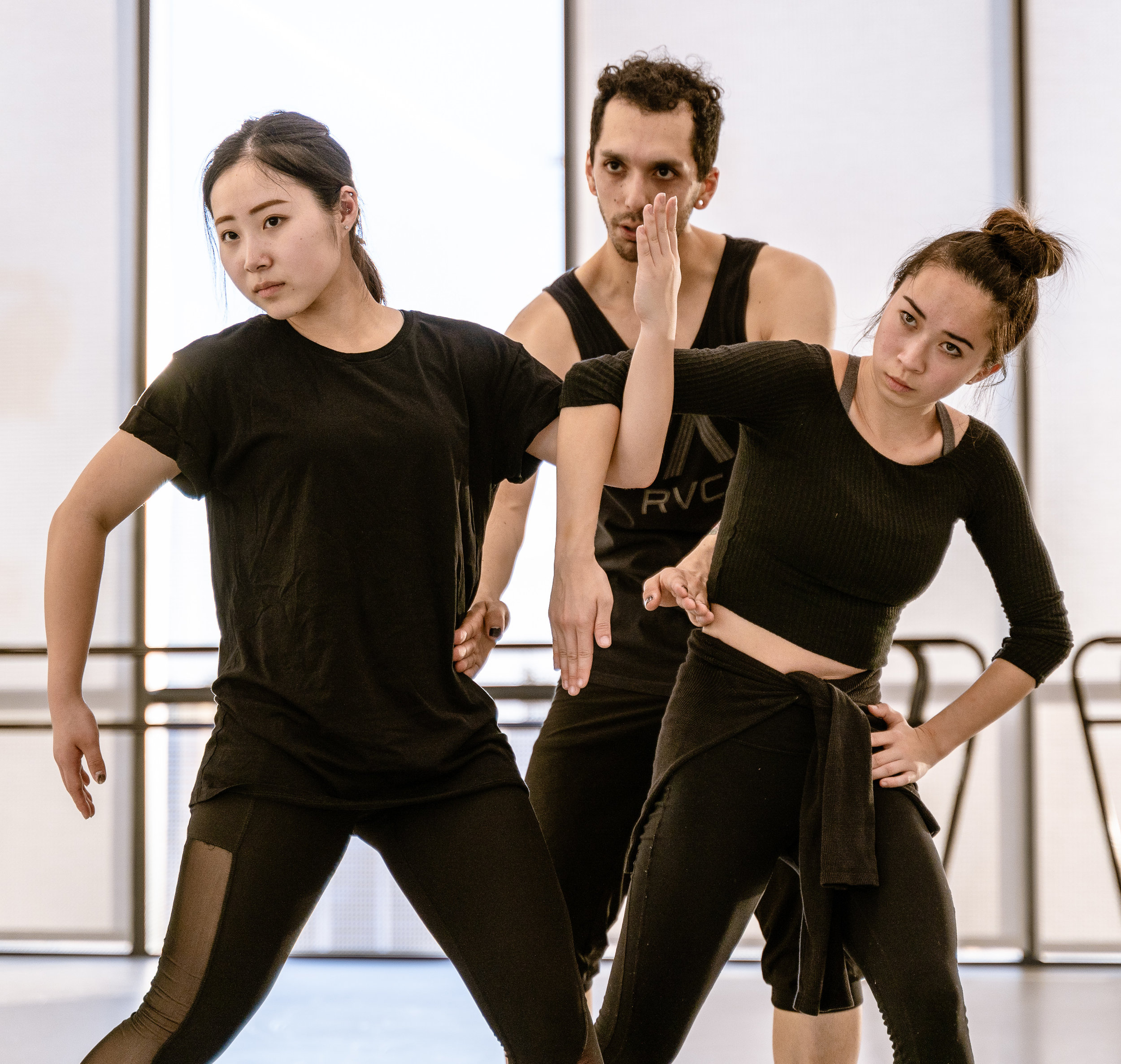 """Student choreographer Erik Fine, 27, from Chicago, works with SMC dance major Yurino Niyama (playing Dante's Beatrice), 19, from Fukuoka, Japan, and SMC dance and chemistry major Tiffany Dong (playing Greed), 20, from San Francisco, in a rehearsal for Fine's new work """"seven"""" at SMC's Core Performance Center on Thursday, March 7, 2019. The work is titled with the number seven written in tally marks. In this section of the dance Beatrice and Greed (Niyama and Dong) dance a duet. """"seven"""" refers to the seven deadly sins and Dante's _Inferno_. In Fine's video game inspired telling, the deadly sins are all game bosses. """"seven"""" will premiere at Synapse Dance Theater at the Broad Stage at SMC's Performing Arts Center campus on Friday and Saturday, May 24 and 25. (Glenn Zucman/The Corsair)"""