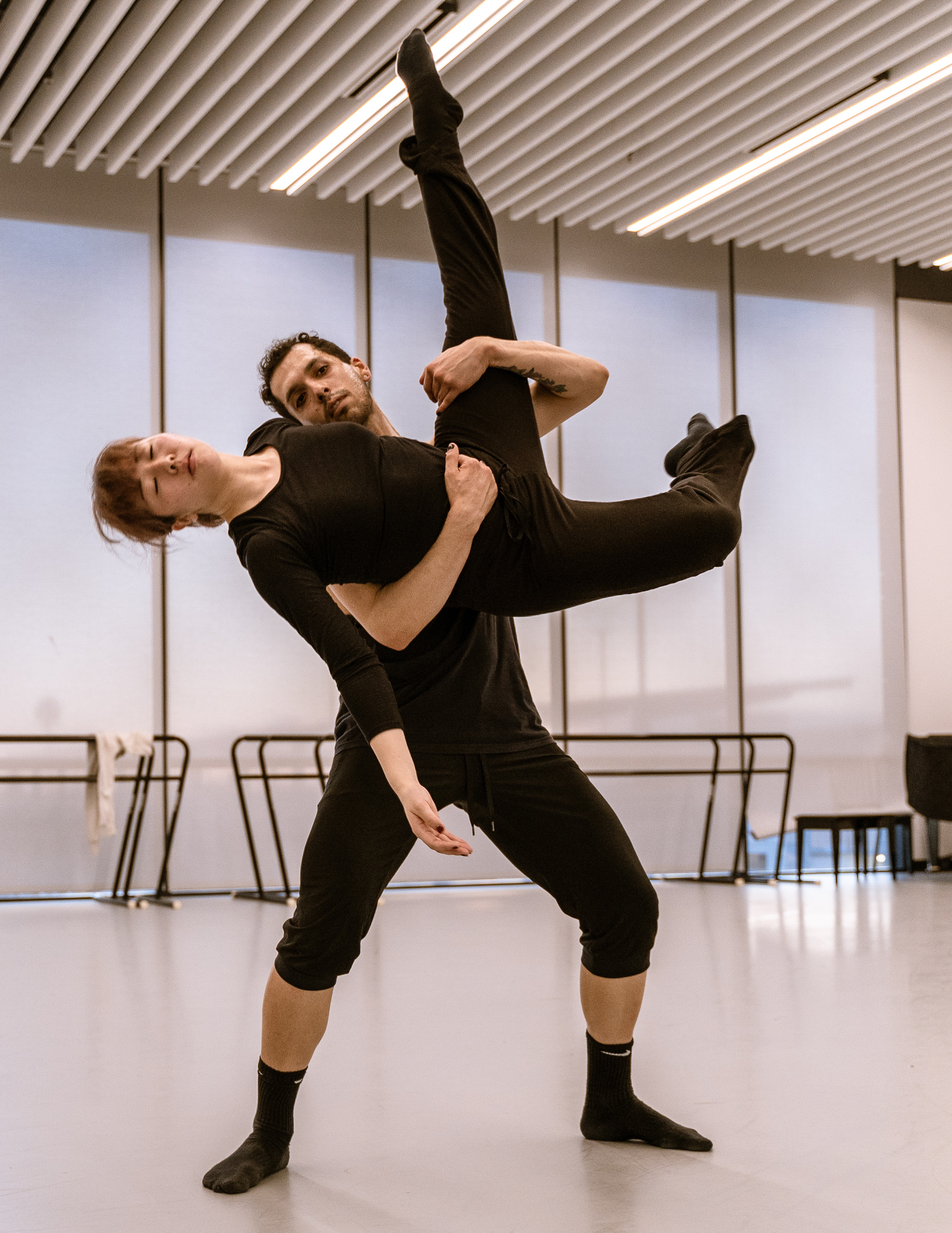 """SMC dance major Mio Kato (playing Envy), 25, from Chiba, Japan, and student choreographer Erik Fine, 27, from Chicago, work on a section of Fine's new work """"seven"""" at SMC's Core Performance Center on Thursday, March 7, 2019. The work is titled with the number seven written in tally marks. """"seven"""" refers to the seven deadly sins and Dante's _Inferno_. In Fine's video game inspired telling, the deadly sins are all game bosses. """"seven"""" will premiere at Synapse Dance Theater at the Broad Stage at SMC's Performing Arts Center campus on Friday and Saturday, May 24 and 25. (Glenn Zucman/The Corsair)"""