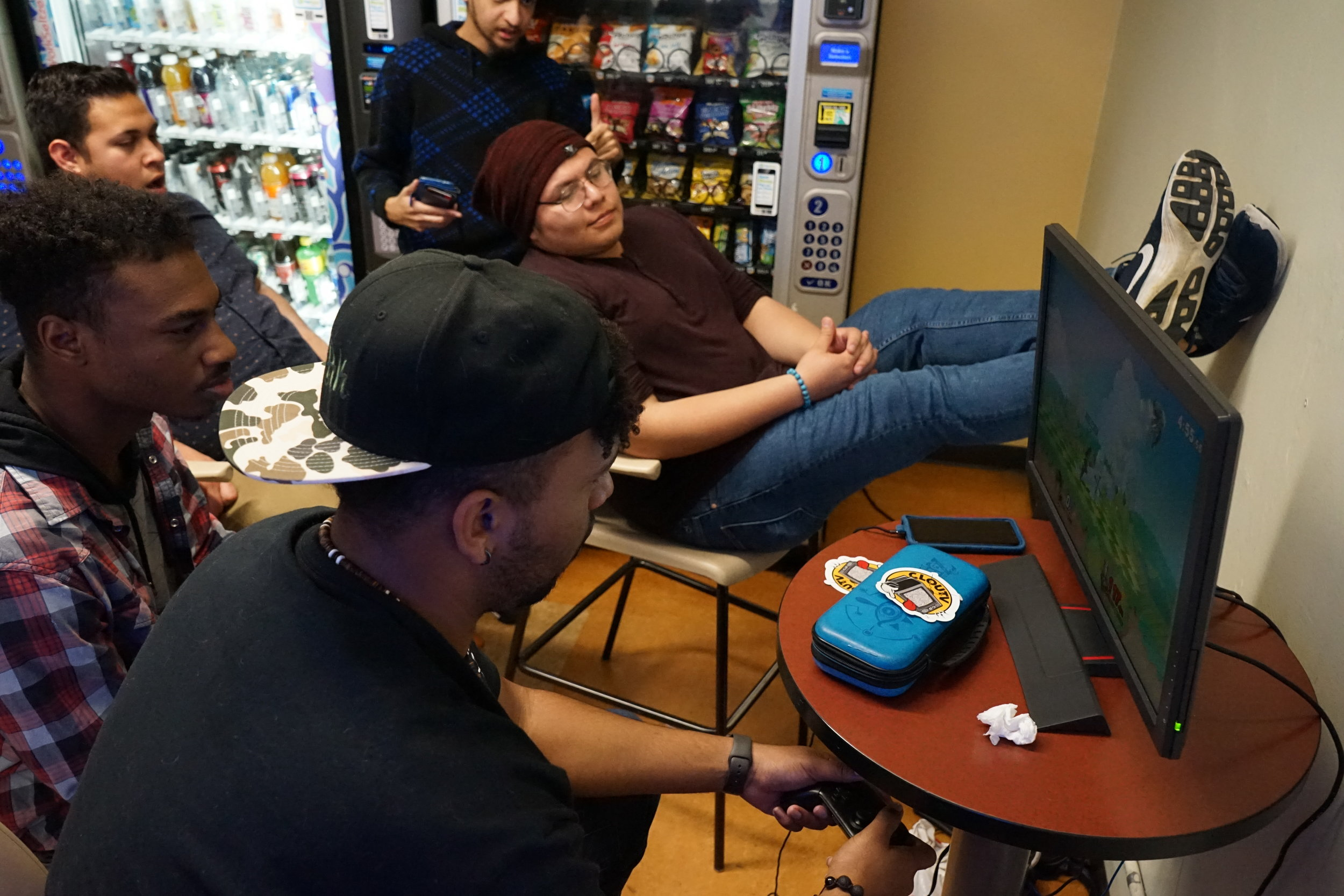 The group of SMC student gamers gathers near the vending machines in the Main Campus cafeteria to play video games and have friendly competitions against each other, Monday, March 4, 2019, in Santa Monica, Calif. Despite their regular meet-ups, the restrictions and qualifications for a club have kept the group from forming an official Gaming Club through the college. (Nicole Haun/The Corsair)