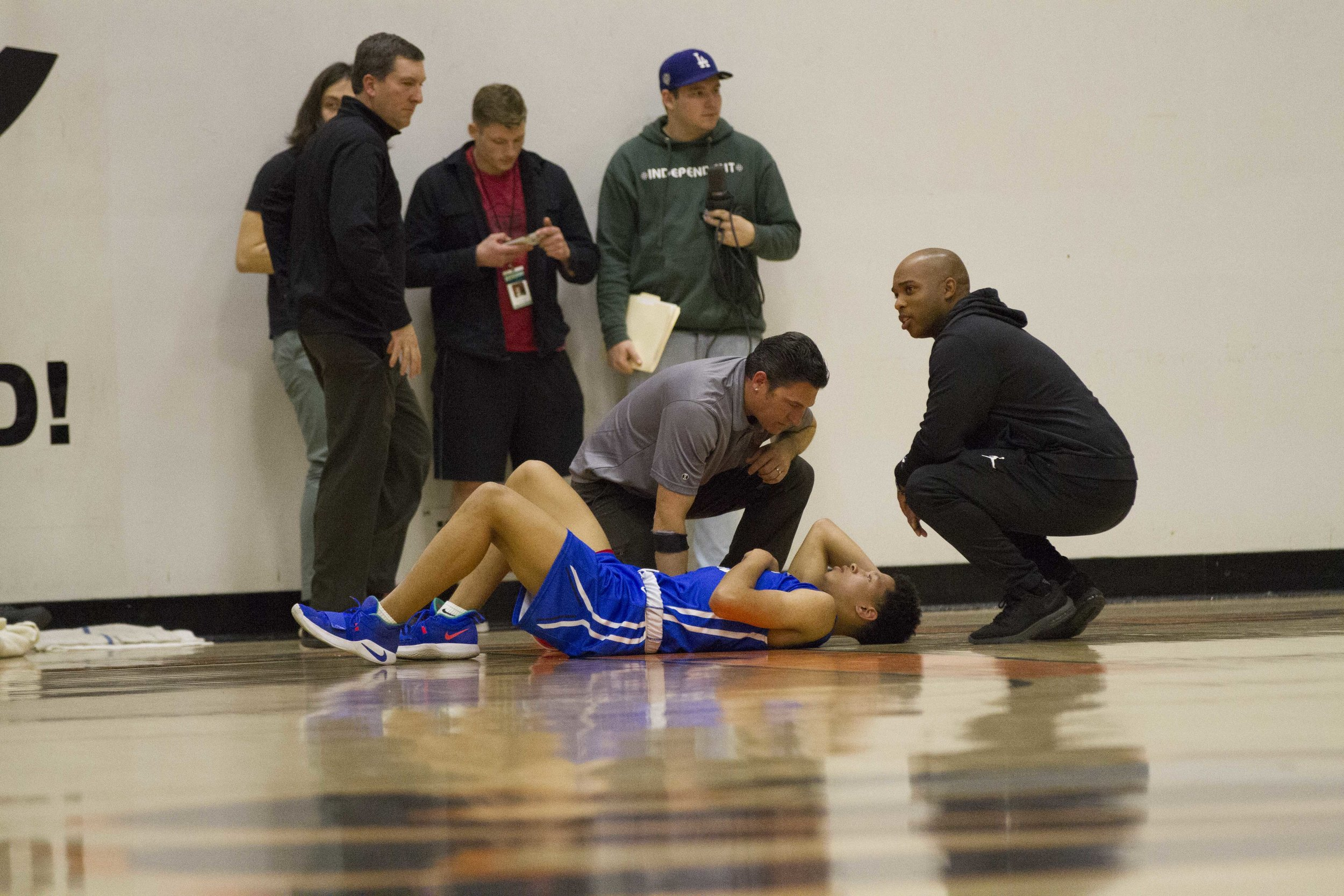 Mekhi Kimble (#2) from the Santa Monica College Corsairs knocked his head on the ground as he fell below the net while playing the San Francisco Rams at the CCCAA Men's Basketball Championship Turnament at Ventura College on Thursday March 14, 2019. Final Score 67-63 for the Rams. Photo by Tanya Barcessat