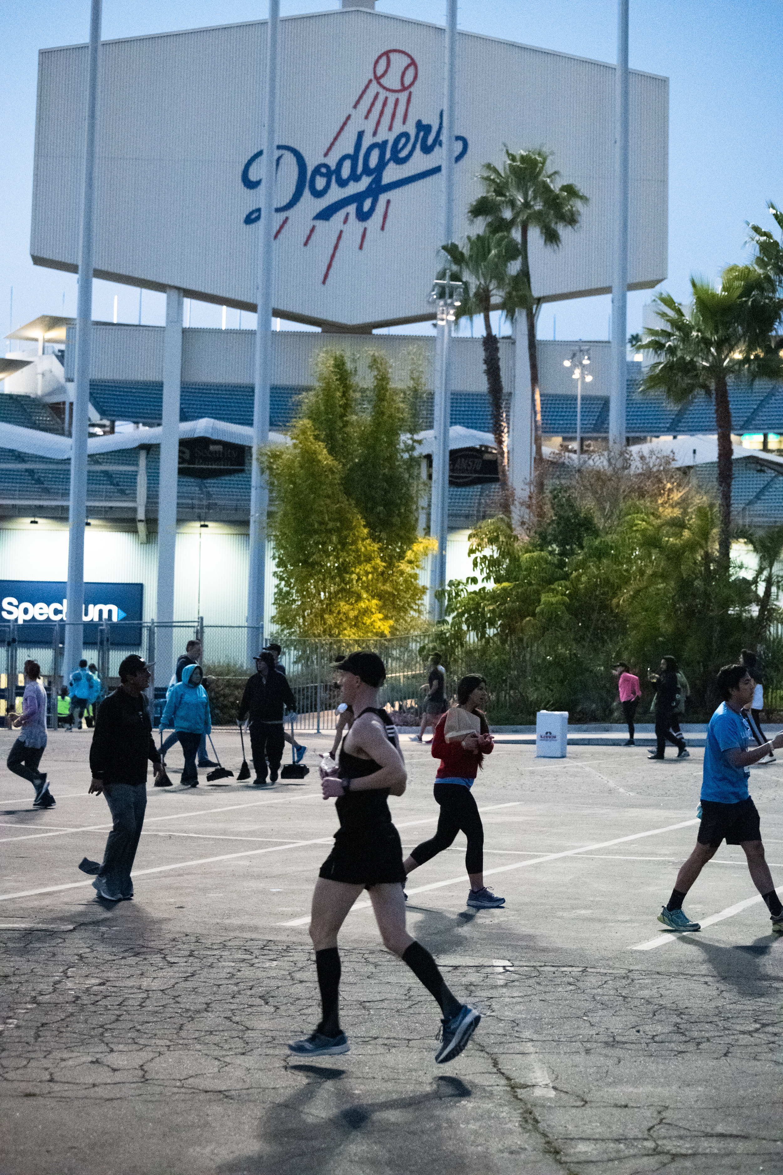 Runners warm-up in the parking lot of Dodger Stadium at the 34th Los Angeles Marathon, Sunday morning, March 24, 2019, in Los Angeles, Calif. (Nicole Haun)
