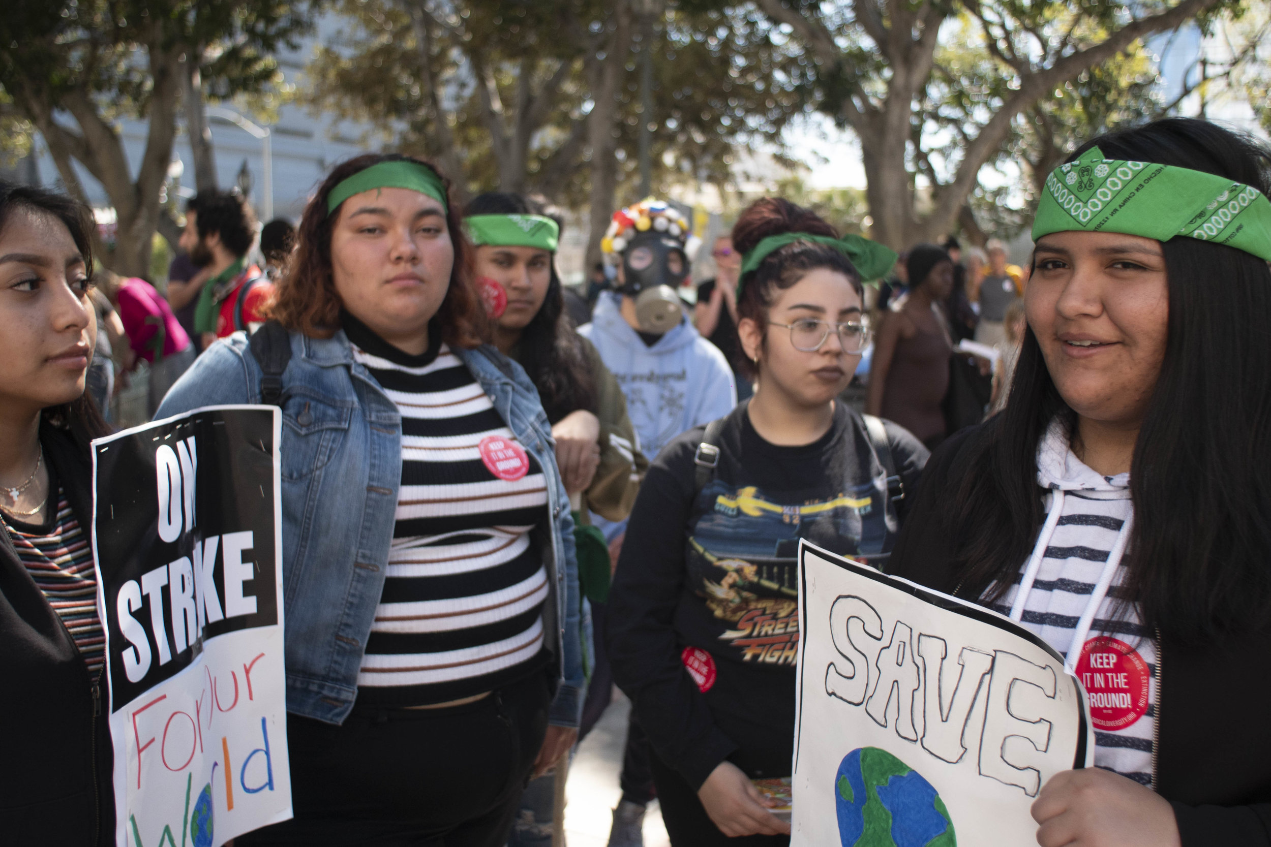 A group of young activist hold signs for the camera during the International Youth Climate Strike, March 15, 2019. (Victor Noerdlinger/Corsair Staff)