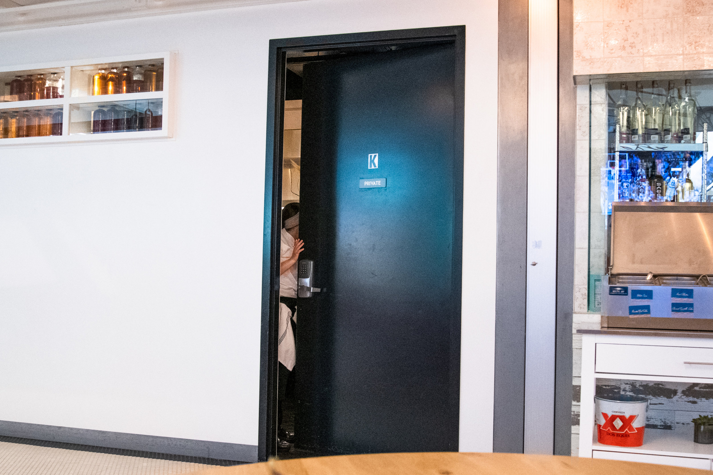"""An inconspicuous black door labeled """"Private"""" leads to a 20-course intimate restaurant inside of a food court off of Santa Monica's 3rd Street Promenade, Thursday, March 21, 2019, in Santa Monica, Calif. The restaurant's name is Dialogue, with acclaimed head chef Dave Beran cooking up seasonal offerings that change monthly. (Nicole Haun/ The Corsair)"""