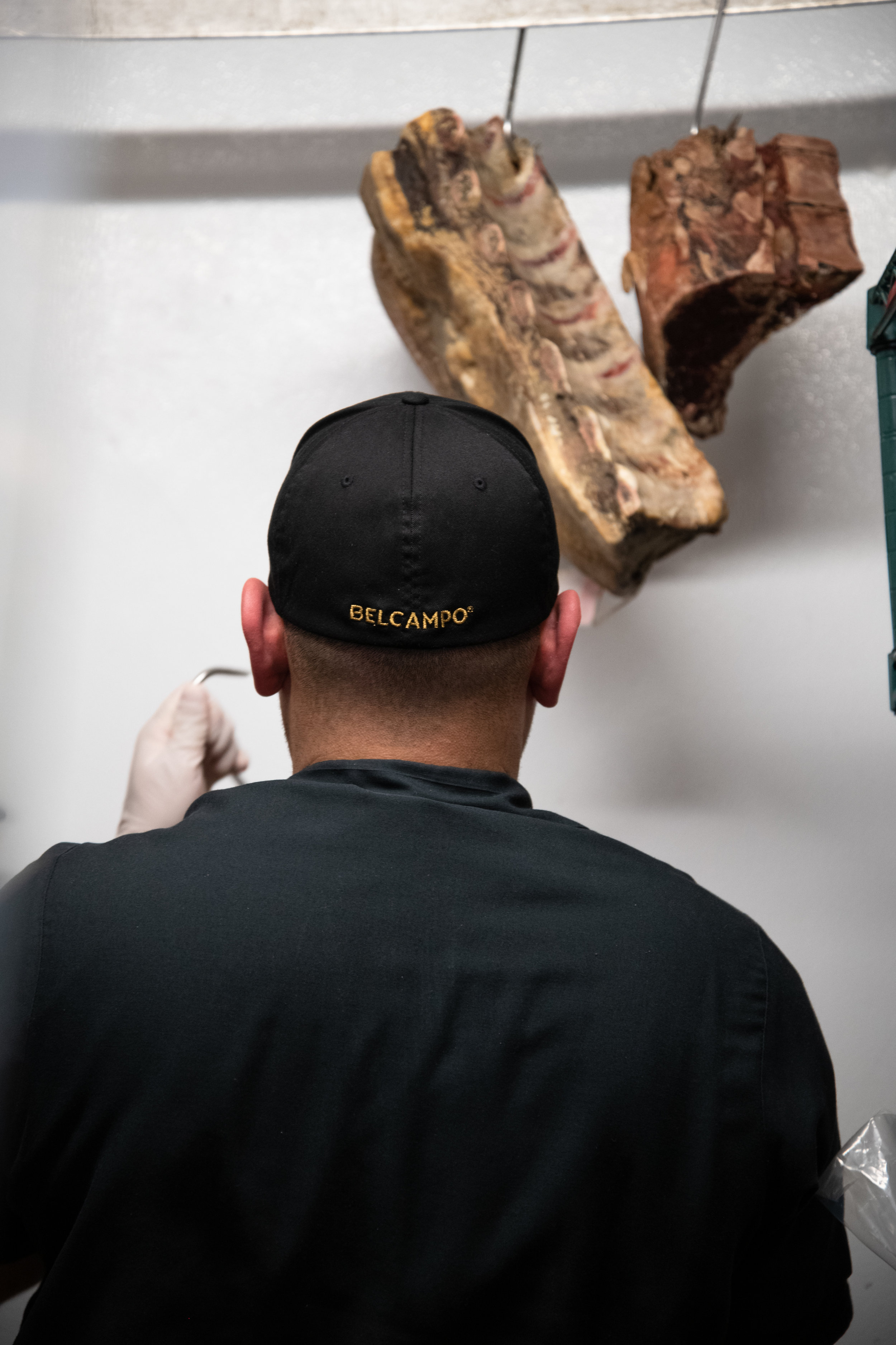 Meats are dry aged inside of the freezer at Belcampo Meat Company, Thursday, March 21, 2019, on Wilshire Blvd. in Santa Monica, Calif. One of the Head Butchers, Miguel Ortiz, hangs a cut that is being aged for 100 days, from the Belcampo farm in northern California. (Nicole Haun/ The Corsair)