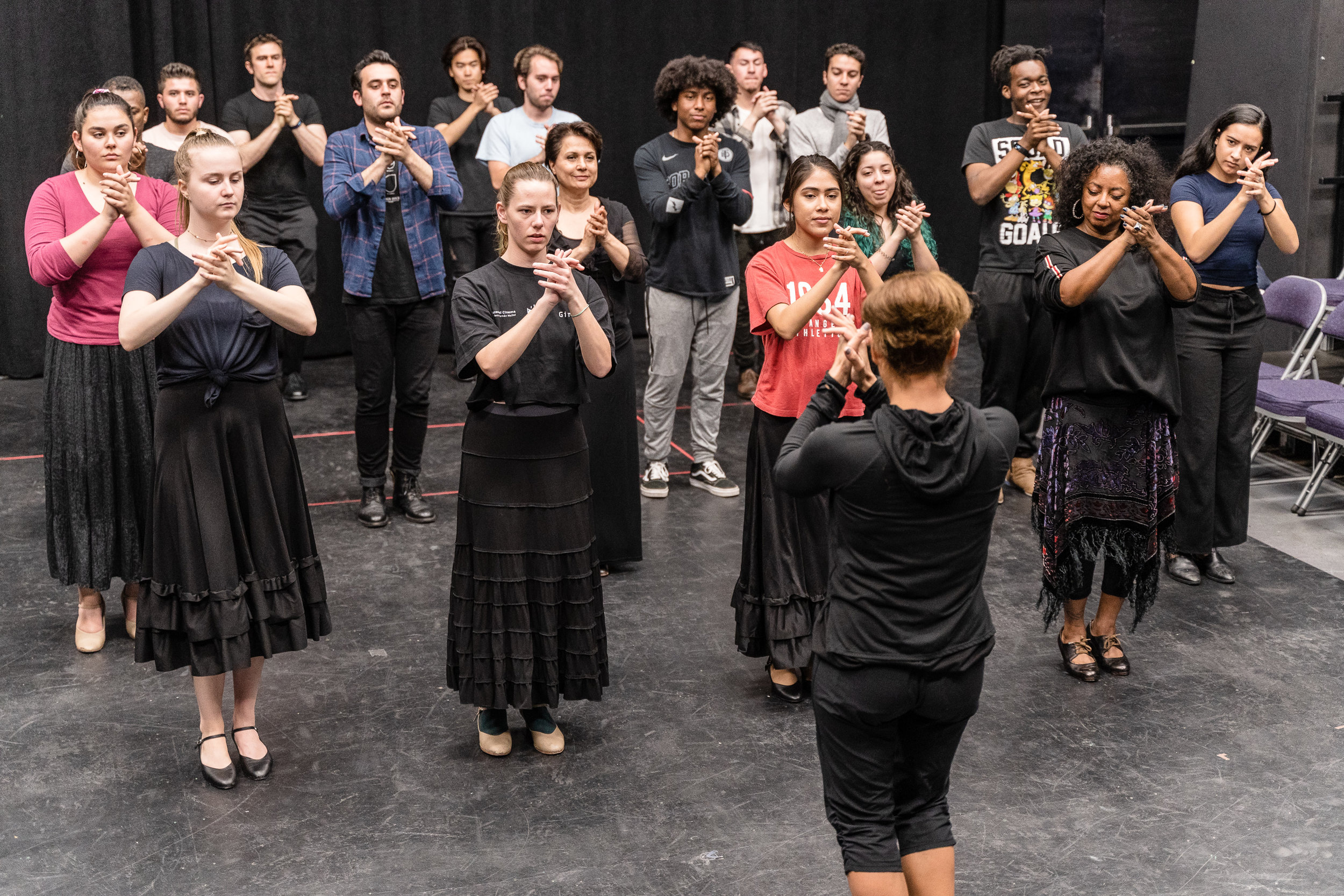 Flamenco Macbeth co-choreographer and SMC Theatre & Dance faculty member Cihtli Ocampo (bottom-center, in all black and facing away) teaches flamenco choreography to the cast of SMC's upcoming production of Flamenco Macbeth at the SMC Studio Stage, the space where Flamenco Macbeth will premiere in a month, on Thursday, March 21, 2019. Flamenco Macbeth is an adaptation of Shakespeare's Macbeth by SMC Theatre Arts department chair Perviz Sawoski. The play will be performed at the SMC Studio Stage, a 100-seat thrust stage, from April 26 through May 5, 2019. (Glenn Zucman/The Corsair)