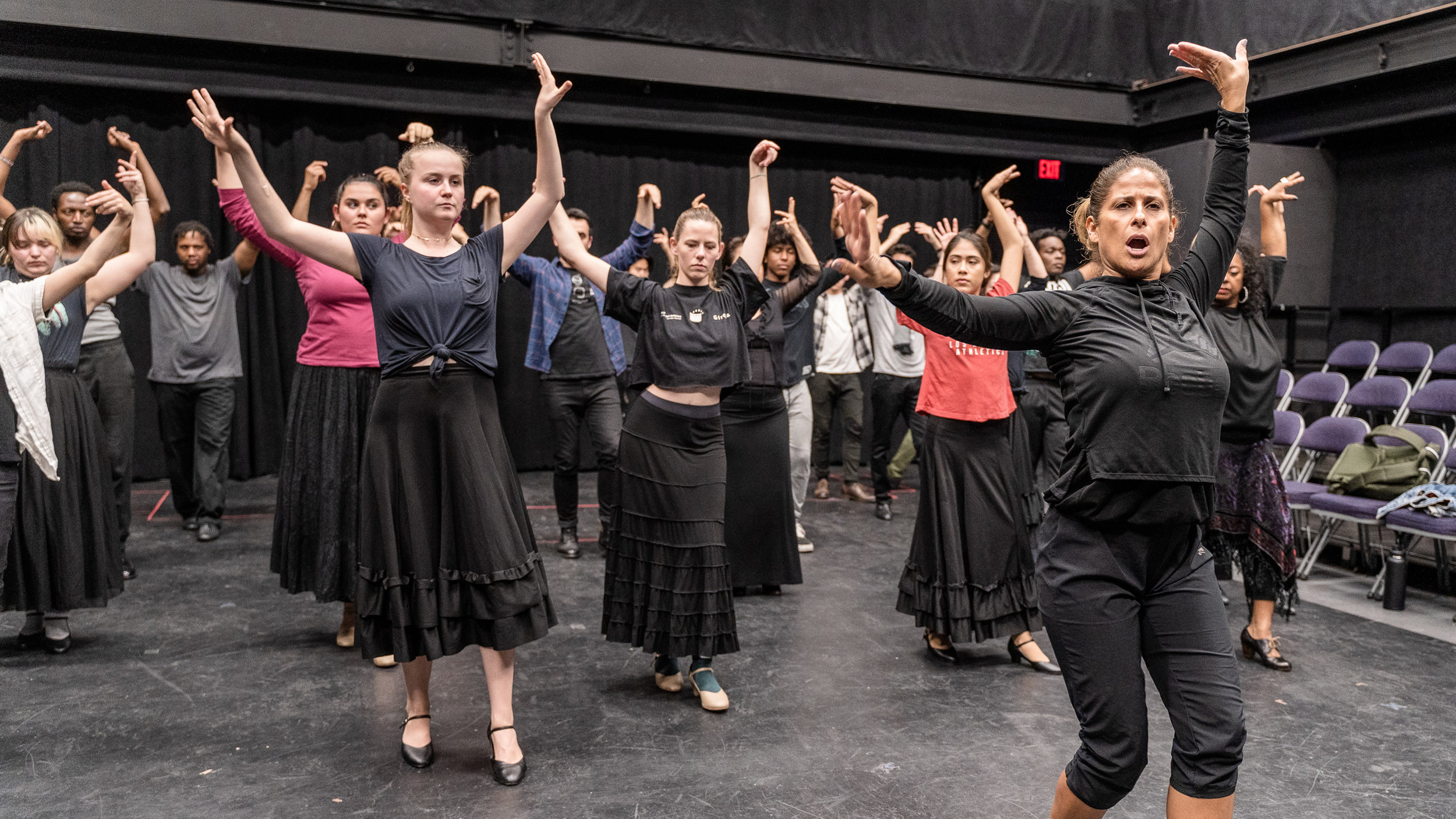 Flamenco Macbeth co-choreographer and SMC Theatre & Dance faculty member Cihtli Ocampo (front-right, in all black) teaches flamenco choreography to the cast of SMC's upcoming production of Flamenco Macbeth at the SMC Studio Stage, the space where Flamenco Macbeth will premiere in a month, on Thursday, March 21, 2019. Flamenco Macbeth is an adaptation of Shakespeare's Macbeth by SMC Theatre Arts department chair Perviz Sawoski. The play will be performed at the SMC Studio Stage, a 100-seat thrust stage, from April 26 through May 5, 2019. (Glenn Zucman/The Corsair)