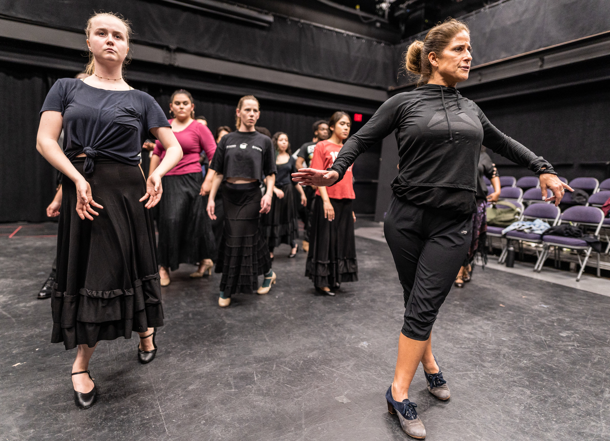 Flamenco Macbeth co-choreographer and SMC Theatre & Dance faculty member Cihtli Ocampo (right) teaches flamenco choreography to Josefin Östevik (left) and the cast of SMC's upcoming production of Flamenco Macbeth at the SMC Studio Stage, the space where Flamenco Macbeth will premiere in a month, on Thursday, March 21, 2019. Flamenco Macbeth is an adaptation of Shakespeare's Macbeth by SMC Theatre Arts department chair Perviz Sawoski. The play will be performed at the SMC Studio Stage, a 100-seat thrust stage, from April 26 through May 5, 2019. (Glenn Zucman/The Corsair)