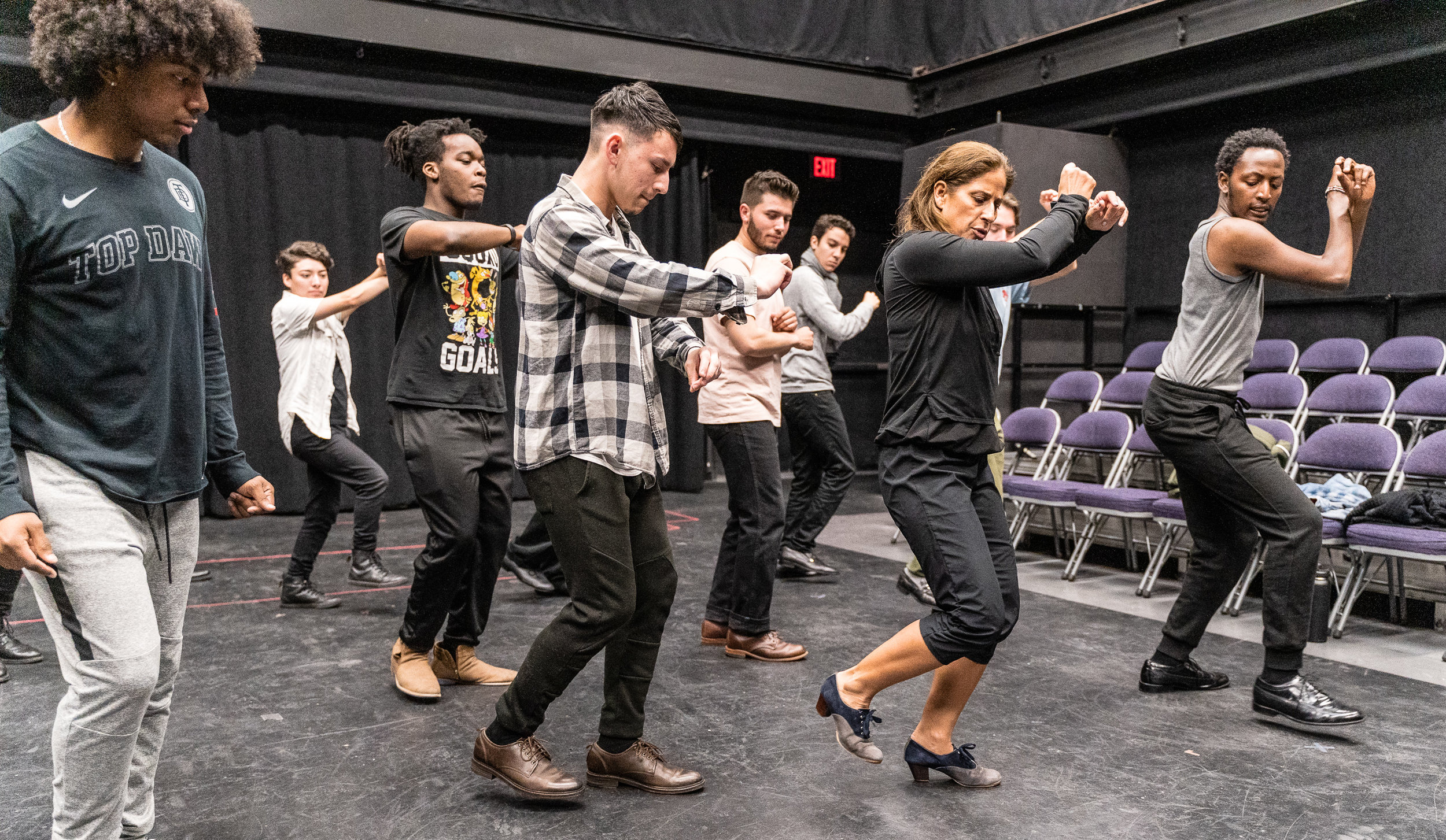 Flamenco Macbeth co-choreographer and SMC Theatre & Dance faculty member Cihtli Ocampo (center-right, in all black) teaches flamenco choreography to the cast of SMC's upcoming production of Flamenco Macbeth at the SMC Studio Stage, the space where Flamenco Macbeth will premiere in a month, on Thursday, March 21, 2019. Flamenco Macbeth is an adaptation of Shakespeare's Macbeth by SMC Theatre Arts department chair Perviz Sawoski. The play will be performed at the SMC Studio Stage, a 100-seat thrust stage, from April 26 through May 5, 2019. (Glenn Zucman/The Corsair)