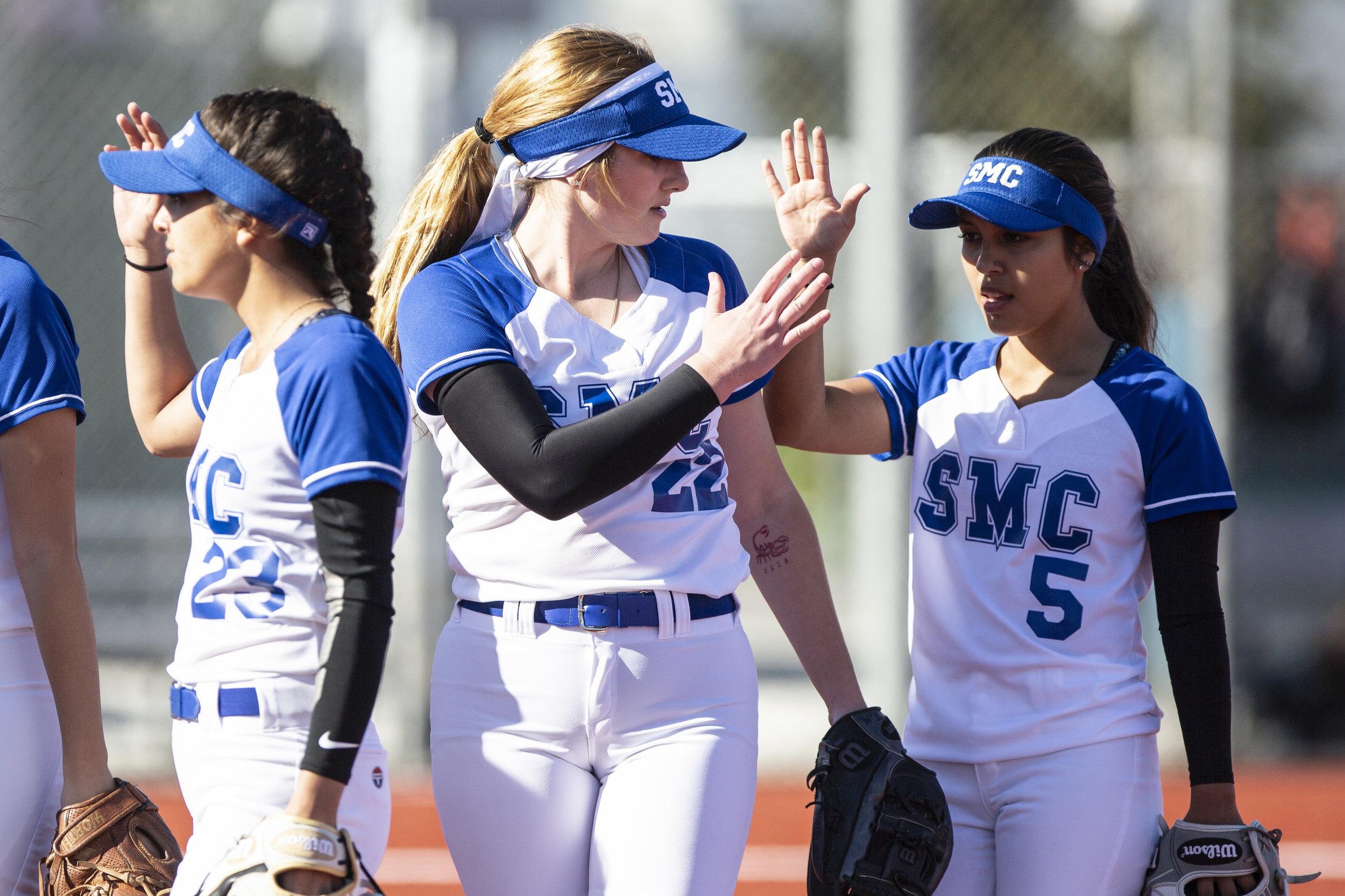 Ireland Miessau (middle) Emma Soto(right) and Taylor Liebesman (left), from Santa Monica College softball team playing at home vs Moorpark team, Thursday, March 7, 2019 in Santa Monica, Calif.