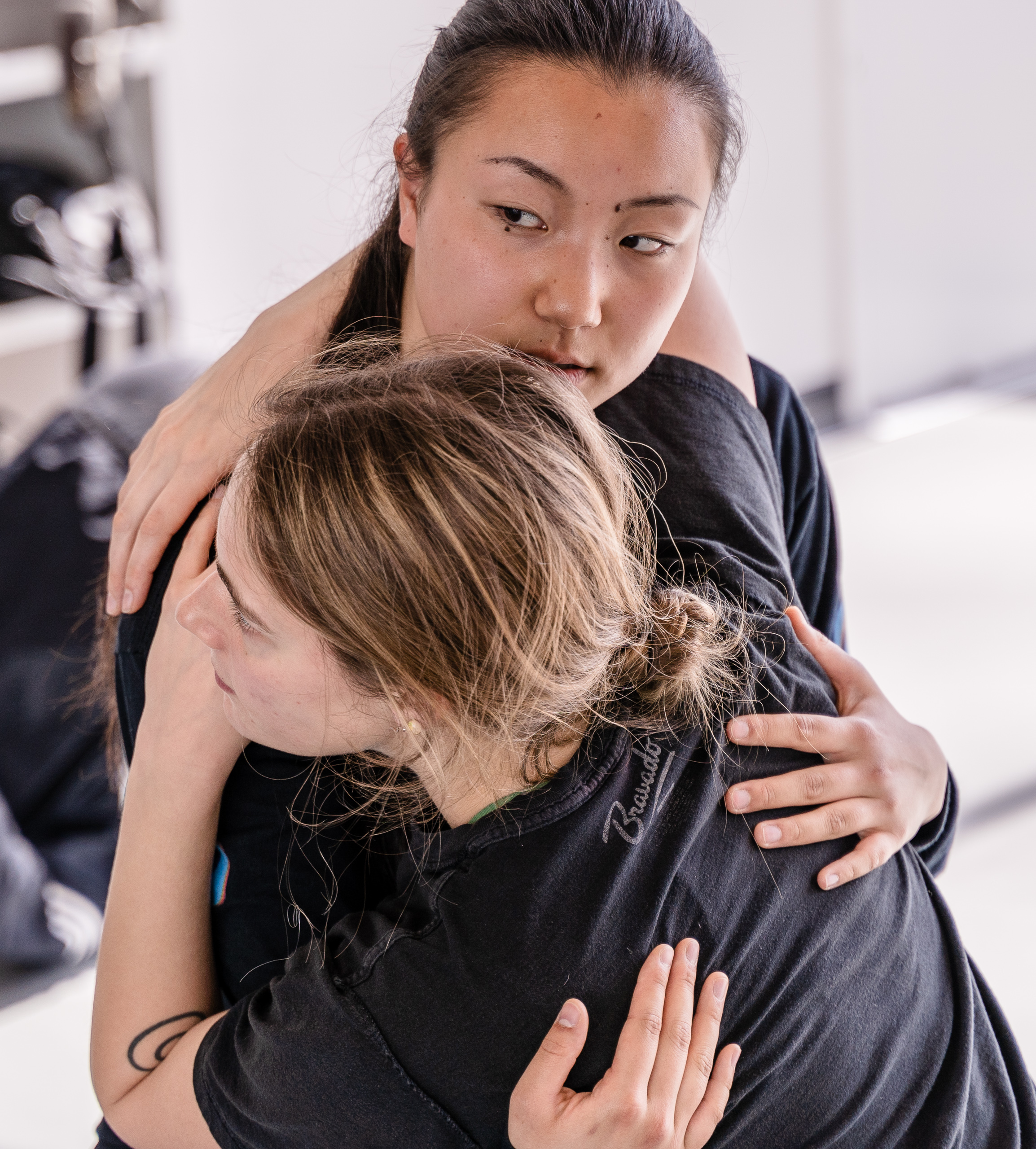 SMC student choreographer Aya Nakaguchi (top) works with Alyssa Fletcher (bottom) to fine tune a movement sequence in Nakaguchi's new, not-yet-titled work for Synapse Dance Theater during a rehearsal in the Core Performance Center (CPC) on Tuesday, April 2, 2019. Synapse Dance Theater will be presented on Friday and Saturday, May 24 and 25, on the SMC Broad Stage at the Performing Arts Complex (PAC) (Glenn Zucman/The Corsair)