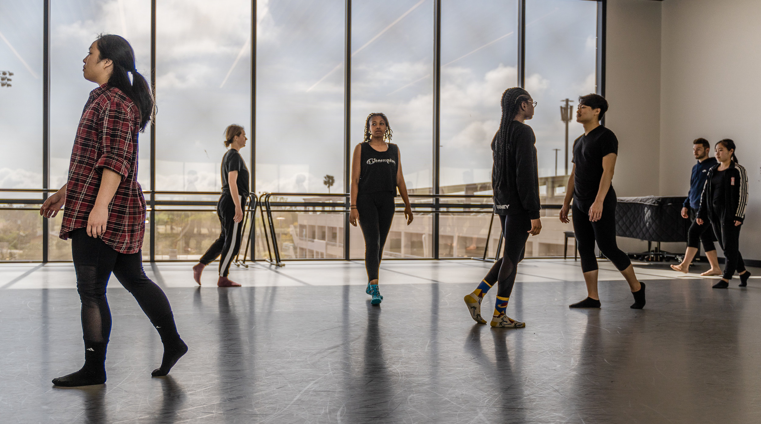 SMC dancers explore movement along a right-angle grid in a rehearsal for student choreographer Aya Nakaguchi's new, not-yet-titled work for Synapse Dance Theater in the Core Performance Center (CPC) on Tuesday, April 2, 2019. Synapse Dance Theater will be presented on Friday and Saturday, May 24 and 25, on the SMC Broad Stage at the Performing Arts Complex (PAC) (Glenn Zucman/The Corsair)
