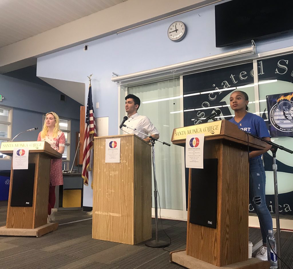 Student Brooke Harrington, debate moderator and organizer Amirreza Toloei, and student Gabrielle Montgomery at the Left, Right, and Center debate at the Cayton Center on April 16, 2019. (Anna Duares/ The Corsair)