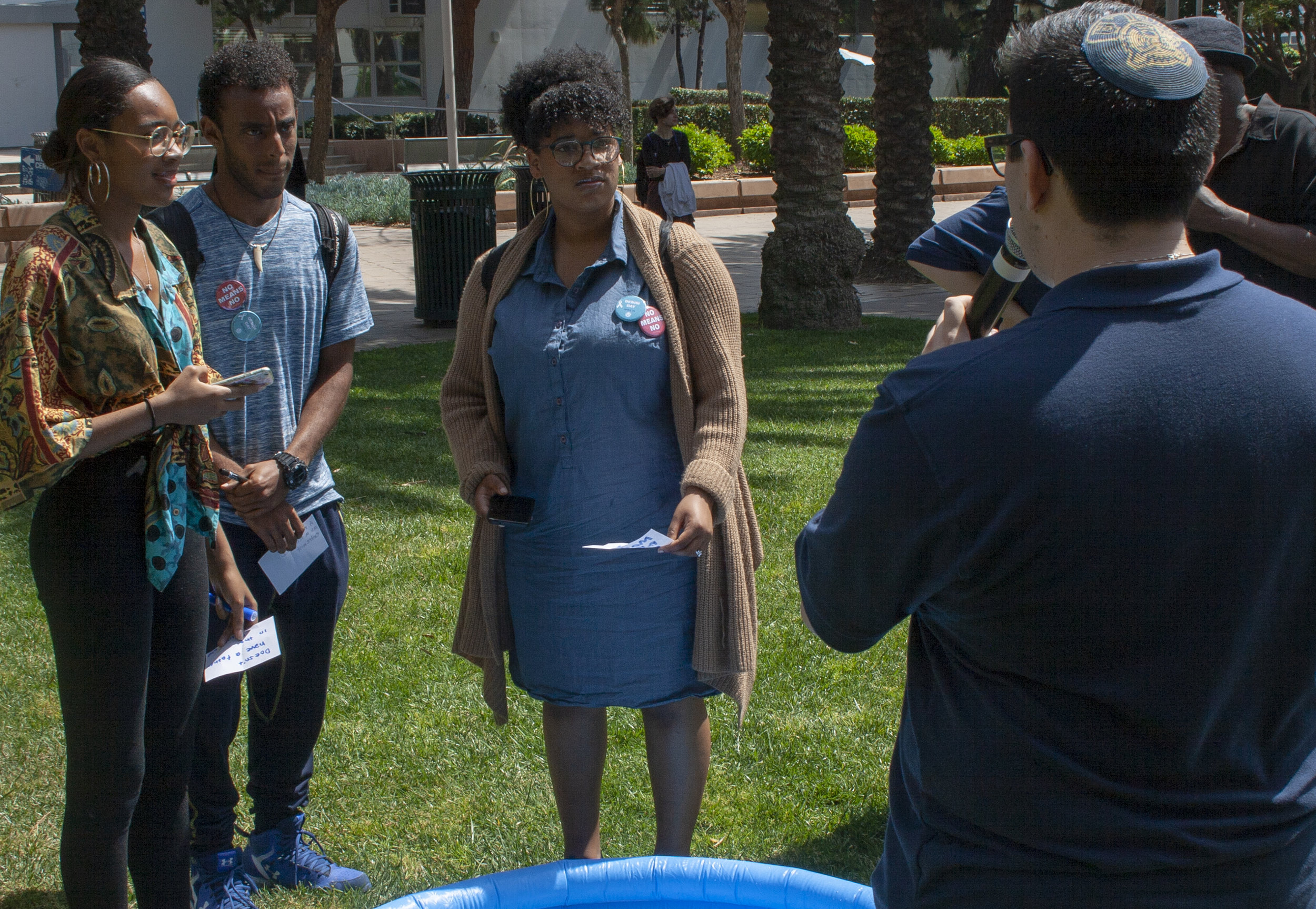 """Students from Santa Monica College participate in an event hosted by the A.S named """"Not On Our Campus"""" this past April 18, 2019. They were all invited to participate in drowning words of hate. The goal of the event was to drown the feelings, stigmas or words of oppression directed to them, so that the water would drown them. (The Corsair/ Janet Ali)"""