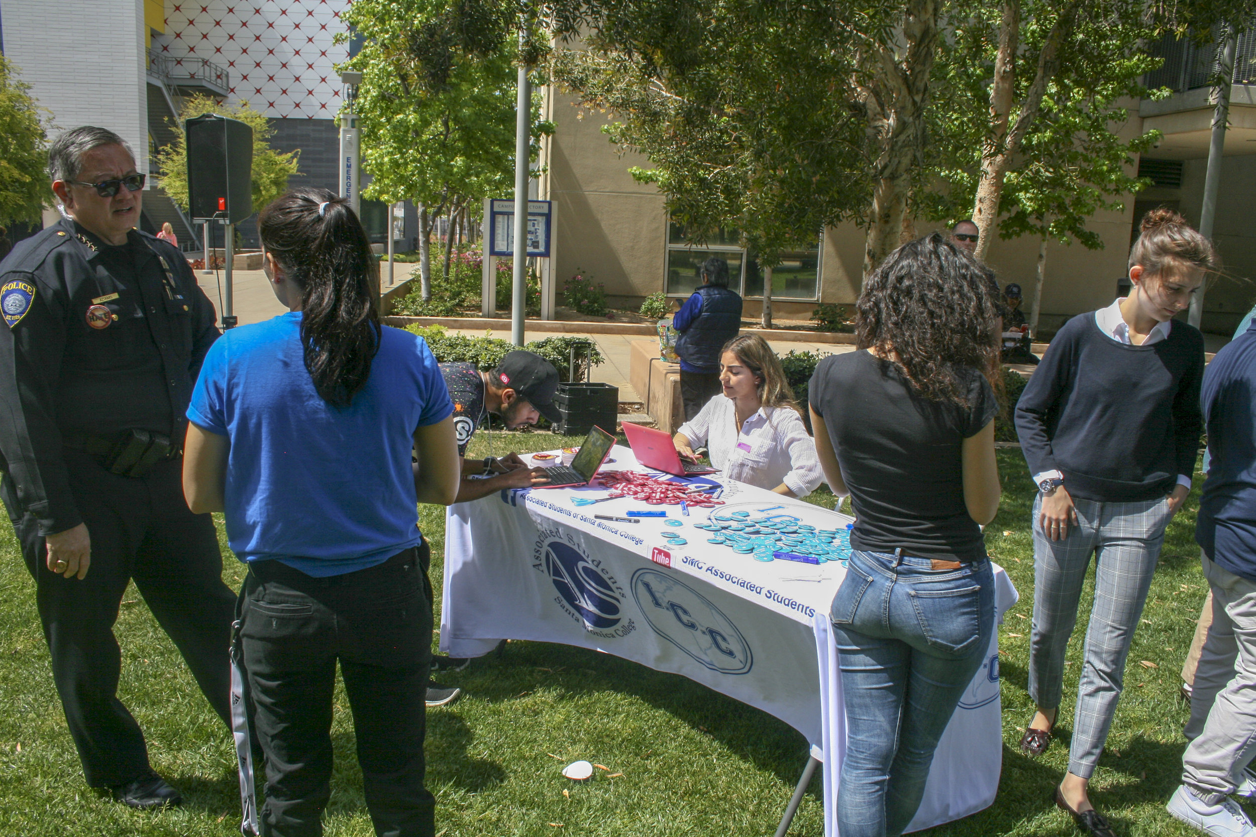 """On April 18, an event hosted by the A.S """" Not On Our Campus"""" took place in Santa Monica College, main campus. The events purpose was to allow students to write on a piece of paper something that bothers them, a stigma, words of oppression, so that it could be washed away by water.(The Corsair/ Janet Ali)"""