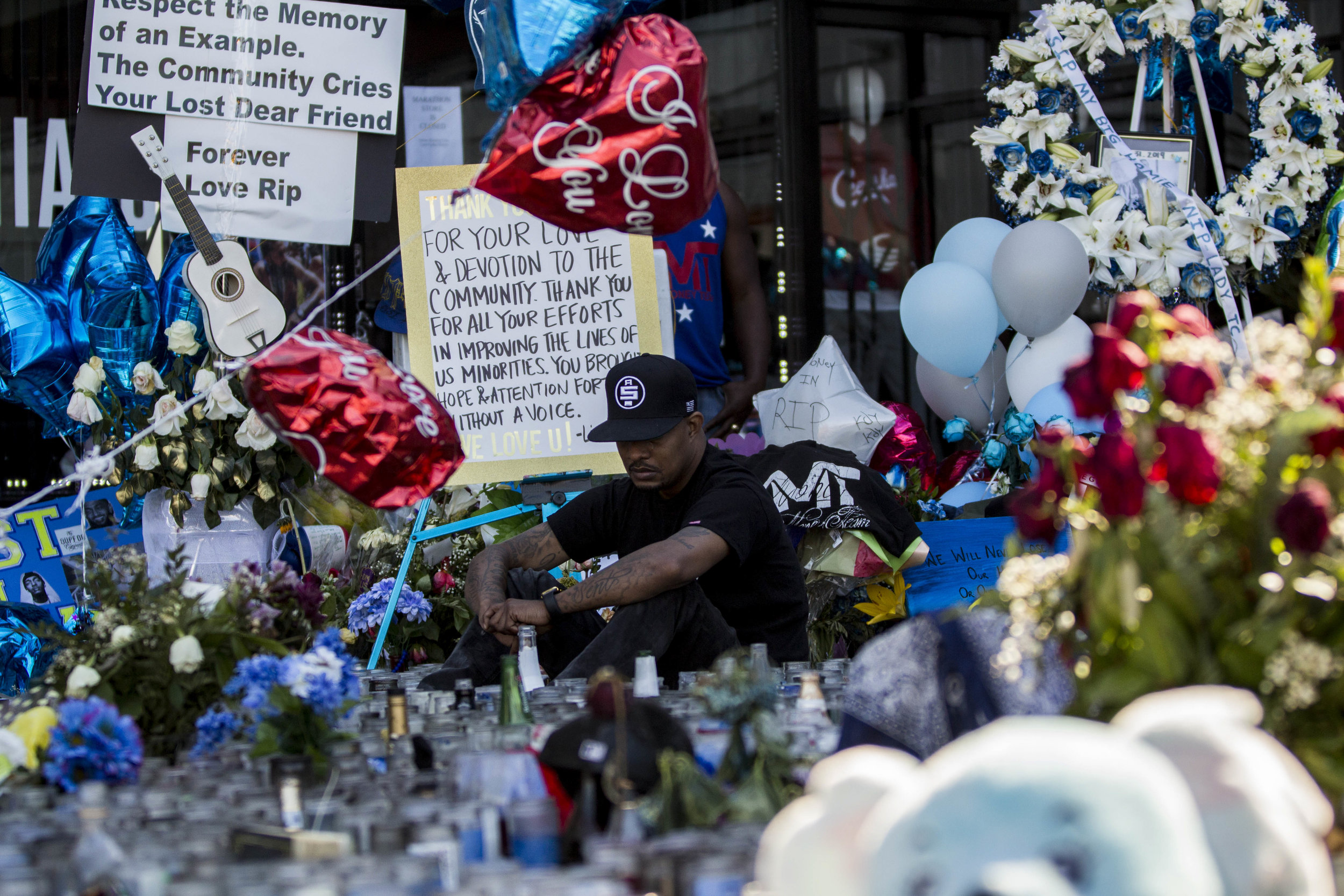 A man pays his respects to Nipsey Hussle at the makeshift memorial in front of The Marathon Clothing store on Slauson Avenue in Los Angeles, California on Wednesday, April 6, 2019. The 33-year-old rapper was murdered on March 31 in front of The Marathon Clothing store which he owned. (Jose Lopez)