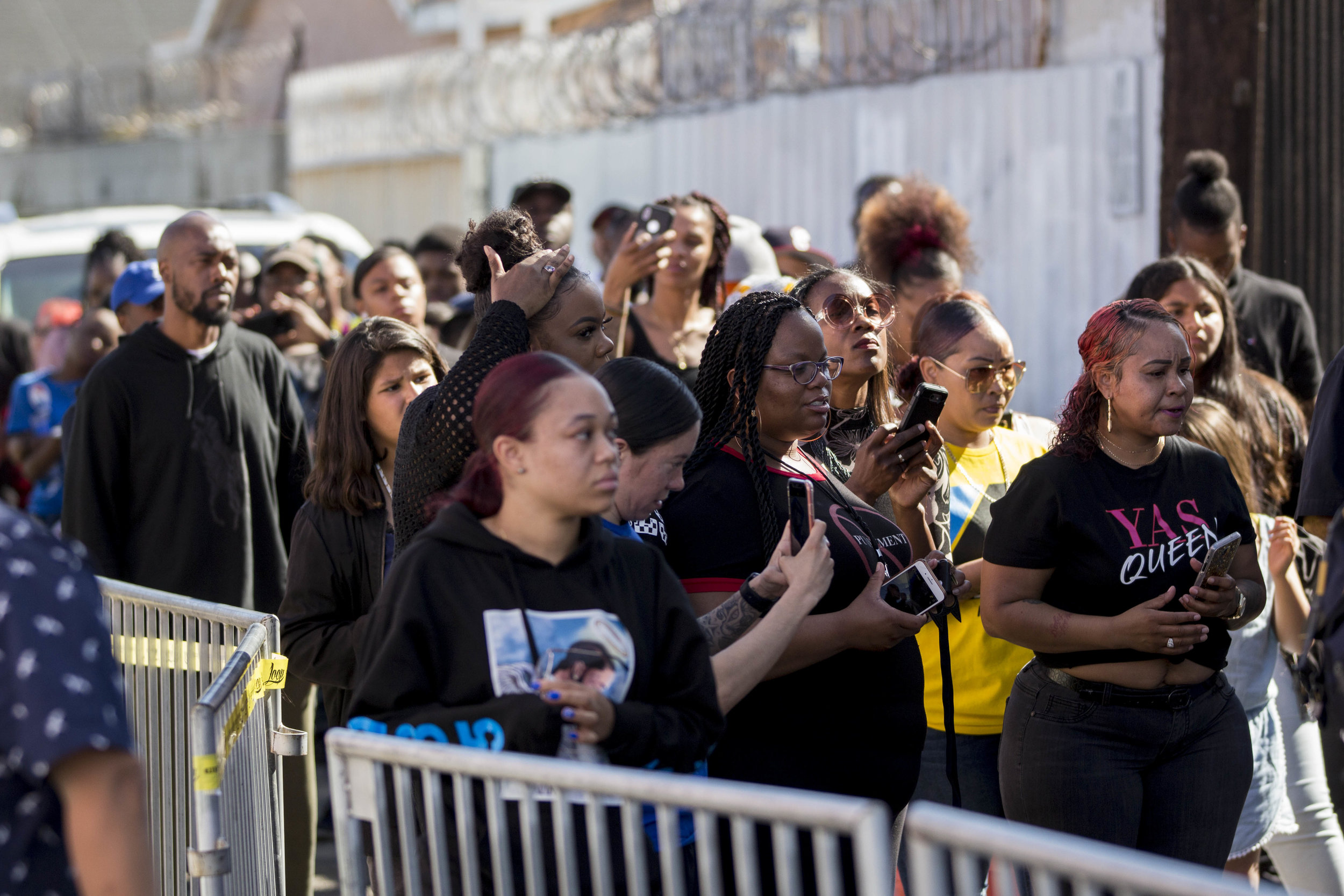 People wait in line for their turn to pay their respects to the slain rapper Nipsey Hussle at the makeshift memorial near The Marathon Clothing store on Slauson Avenue in Los Angeles, California on Wednesday, April 6, 2019. The 33-year-old rapper was murdered on March 31 in front of The Marathon Clothing store which he owned. (Jose Lopez)