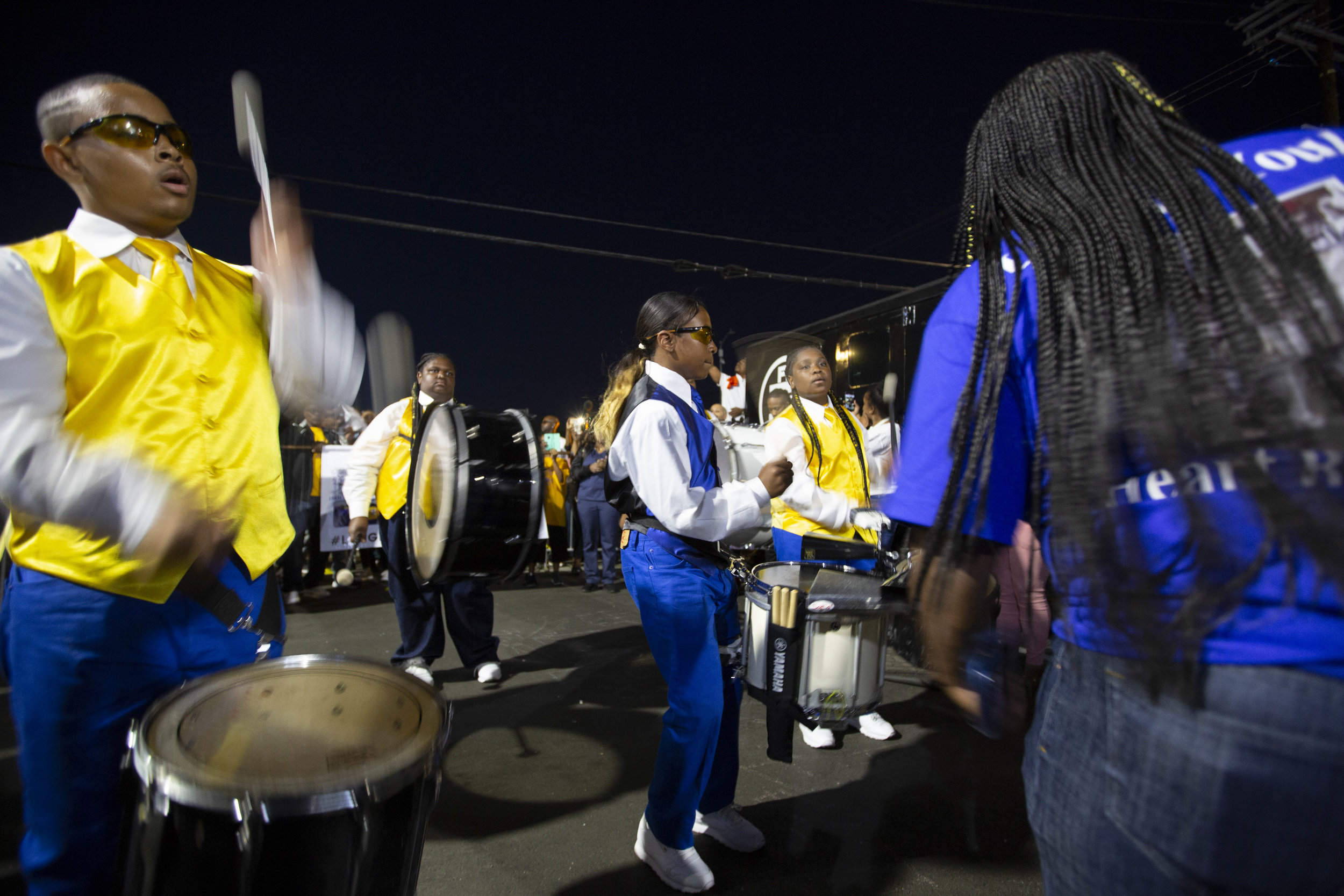The Los Angeles Parmelettes Drumline marches up to the makeshift memorial for Nipsey Hussle and performs for fans paying their respects at The Marathon Clothing store on Slauson Avenue in Los Angeles, California on Wednesday, April 6, 2019. The 33-year-old rapper was murdered on March 31 in front of The Marathon Clothing store which he owned. (Jose Lopez)