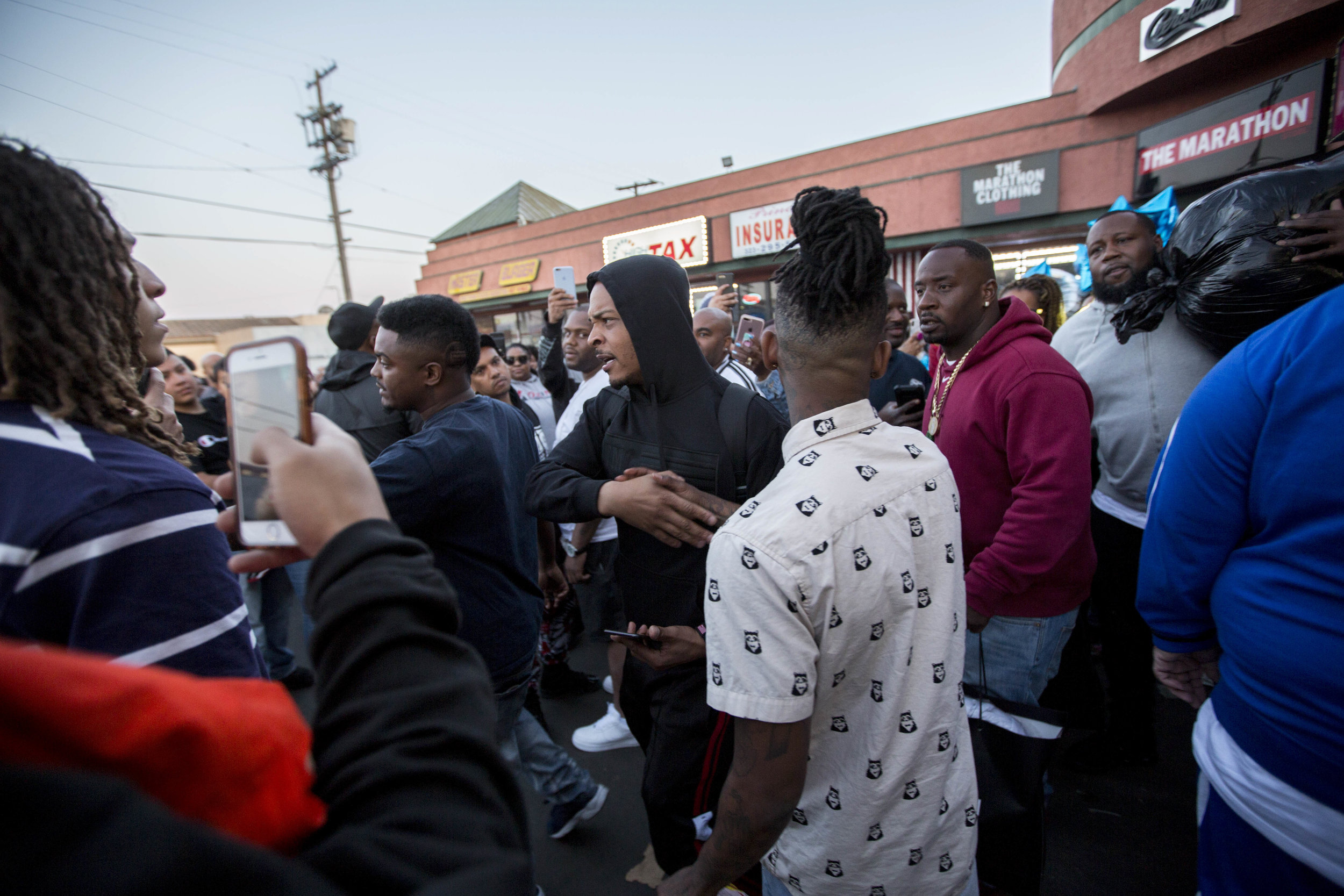 T.I., the rapper, greets fans as he leaves The Marathon Clothing store, after buying bags of clothing, on Slauson Avenue in Los Angeles, California on Wednesday, April 10, 2019. T.I. is one of many celebrities who have made their way to the store to buy out the merchandise in support of Nipsey Hussle and the family. The 33-year-old rapper was murdered on March 31 in front of The Marathon Clothing store which he owned. (Jose Lopez)